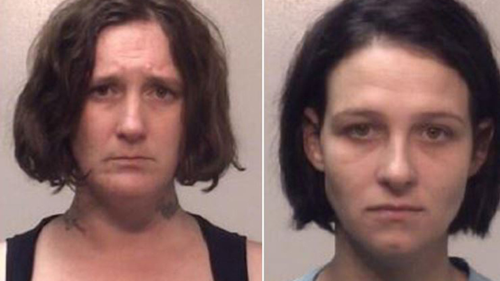 Mother Emma Nolan and tattoo artist Brenda Gaddy are facing charges over the new ink. Image: Coweta County Jail.