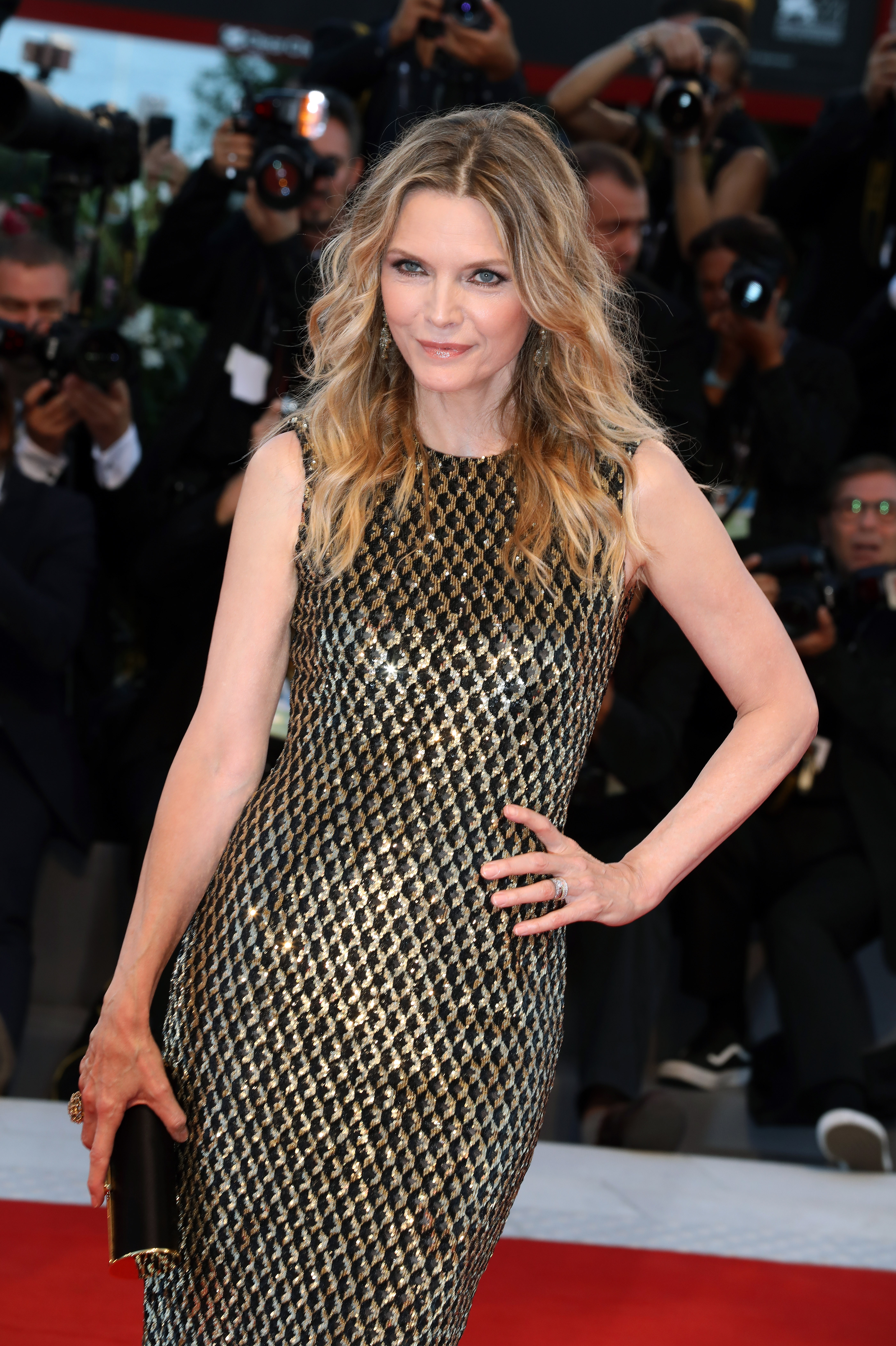 "<p>Michelle Pfeiffer, 59, took Bruno Mars' lyrics to <em>Uptown Funk</em> to heart for her red carpet return alongside Jennifer Lawrence at the Venice Film Festival.</p> <p>The star of <em>Grease 2, Scarface, Dangerous Liaisons</em> and the upcoming <em>Mother </em>dazzled in a golden gown from US designer Michael Kors with a Tods clutch.</p> <p>While the lyric ""Michelle Pfeiffer, that white gold,"" might have inspired her metallic moment on the red carpet, the accomplished actress and mother-of-two has mixed feelings about the song.</p> <p>""I was really shocked and bewildered and kind of flattered,"" Pfeiffer told <a href=""http://wcbsfm.cbslocal.com/2017/05/18/michelle-pfeiffer-on-hearing-her-name-in-bruno-mars-uptown-funk/"" target=""_blank"">CBS FM</a>'s Brad Blanks in May. ""Wow, that's cool. But sometimes I'm in an exercise class and I'm kind of embarrassed!""</p> <p>Pfeiffer wasn't the only style standout on in Venice, with co-star Lawrece exquisite in Christian Dior haute couture and British theatre royalty Rebecca Hall sleek in Armani.</p> <p>See the red carpet winners (and losers, sorry Diane Kruger but what were you thinking?) here.</p> <p> </p>"