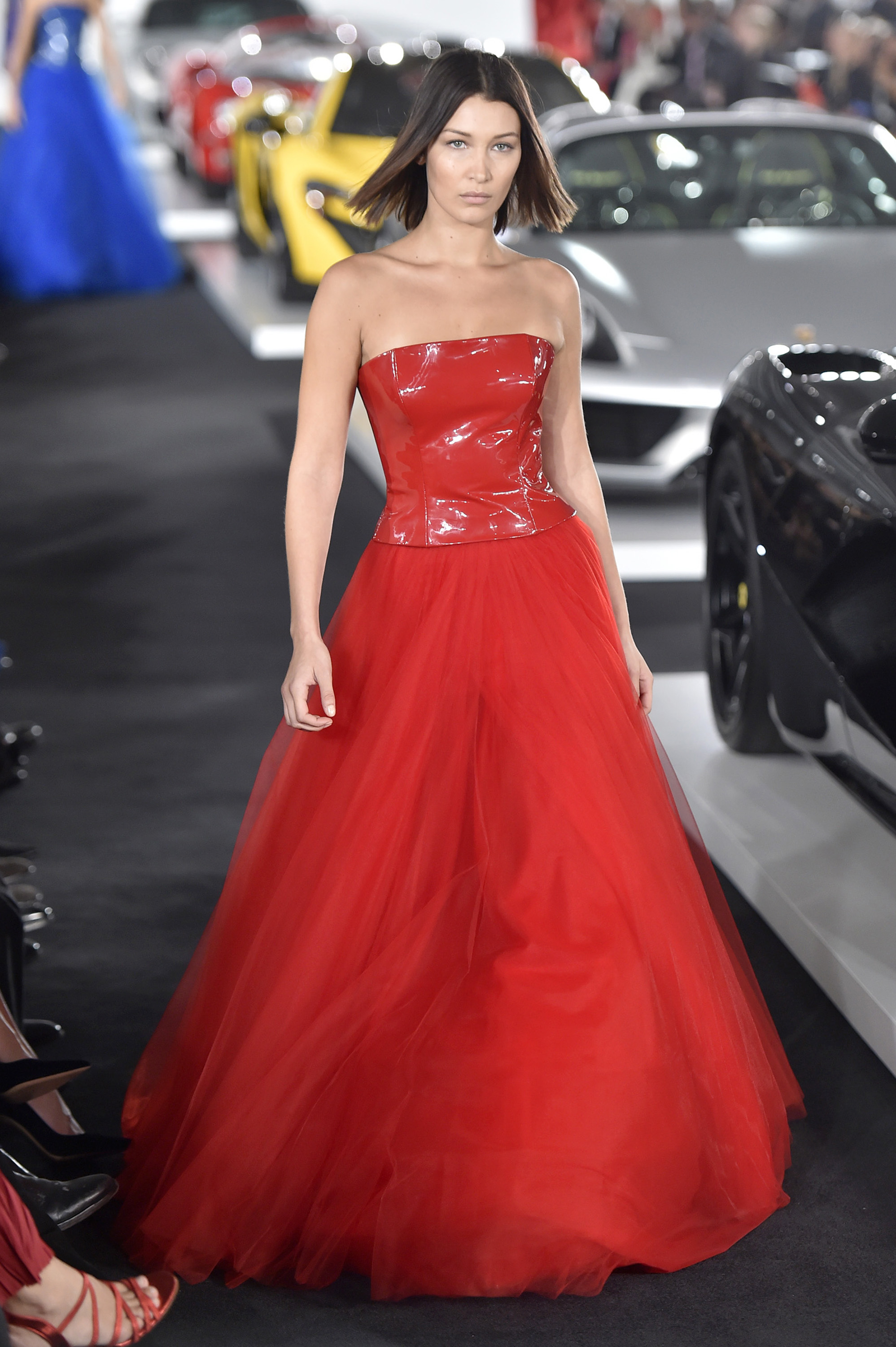 "<p><a href=""http://style.nine.com.au/bella-hadid"" target=""_blank"">Models of the moment Bella Hadid </a>and <a href=""https://style.nine.com.au/kendall-jenner"" target=""_blank"">Kendall Jenner</a> have strutted their stuff for designer Ralph Lauren's Spring/Summer 2018 show, which took place in the garage of his New York home.</p> <p>In a clever twist, the runway cut through the middle of Lauren's warehouse-sized garage where he houses his collection of rare and extremely valuable luxury cars.</p> <p>A gaggle of the hottest models in the business added to the excitement. Most notable were Kendall and Bella and <a href=""https://style.nine.com.au/anwar-hadid"" target=""_blank"">her younger brother Anwar</a>, who is quickly carving out a name for himself as a versatile and dare we say, charming model.</p> <p>Then there was Victoria's Secret angels Romee Strijd, Taylor Hill and Cindy Crawford's son Presley Gerber, all of whom helped Lauren debut his new designs while some of Hollywood's biggest names watched on.</p> <p>A-list guests included Diane Keaton, Jessica Chastain, Katie Holmes, Sistine Stallone, Poppy Delevingne and Diane von Furstenberg.</p> <p>The crowd sipped champagne in the company of the valuable vintage sports cars that included a 1955 Porsche 550 Spyder and a rare 1938 Bugatti 57SC estimated to be worth a staggering $40 million.</p> <p>The luxury cars brought the cool while the clothes brought the chic. Models walked past the automobile line-up in slim skirts, tailored jackets, plaid suits and luxurious coats.</p> <p>Bella's show-stopping red ball gown was a runway highlight.</p> <p>""Still in awe and dreaming about last night...Thank you for opening your incredible garage of the most beautiful, sexy, special vehicles I have ever had the privilege of seeing in my life @ralphlauren,""</p> <p>""And thank you to the team at RL for making my dream look that I'll probably be wearing to my wedding one day,"" <a href=""https://www.instagram.com/p/BY_ZLtqHQPt/?taken-by=bellahadid"" target=""_blank"">Hadid wrote on Instagram.</a><br> Click through to see the highlights from Ralph Lauren's star-studded S/S'18 show.</p>"
