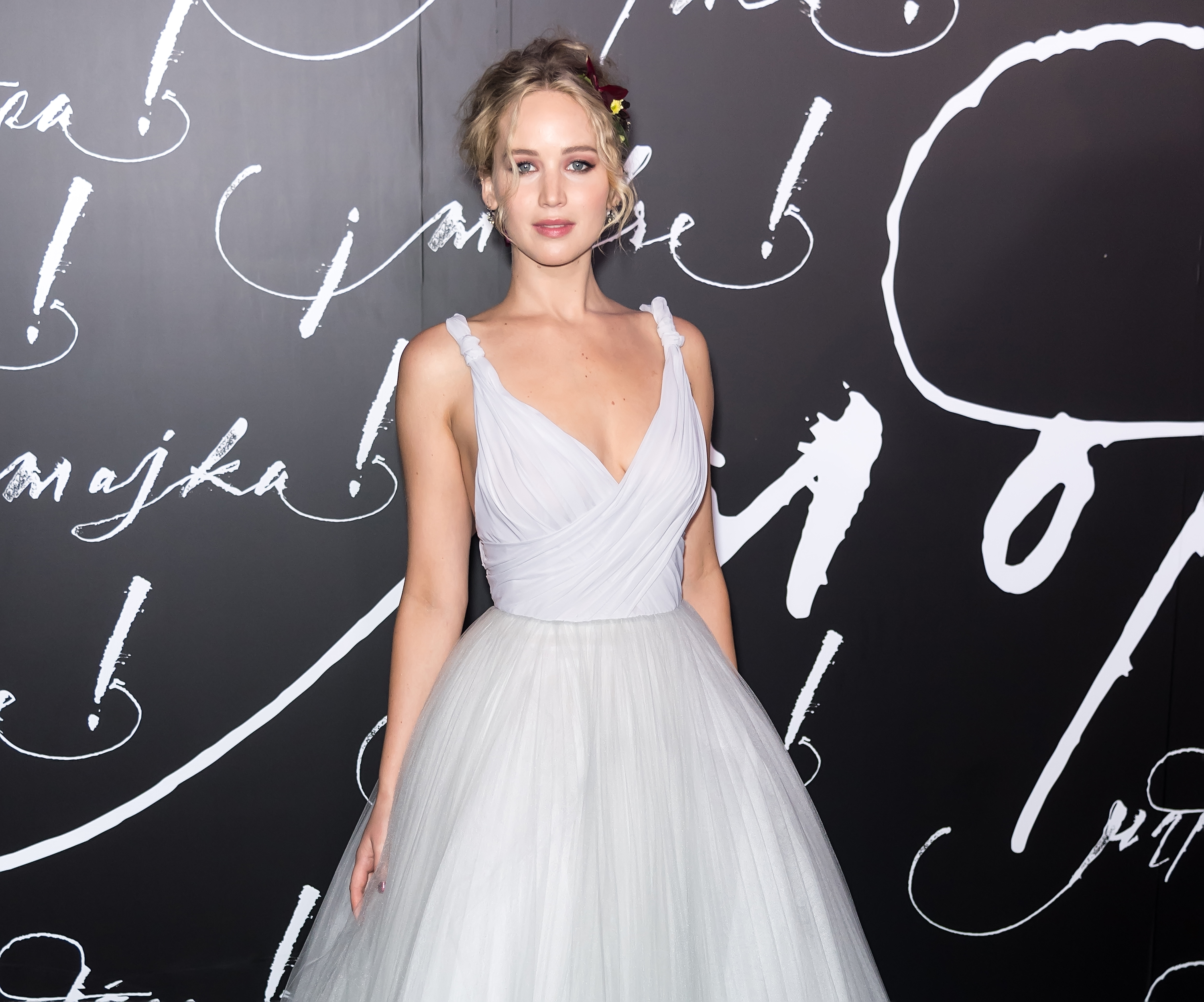 "<p><a href=""http://style.nine.com.au/2017/08/10/12/55/jennifer-lawrence-vogue-cover"" target=""_blank"" draggable=""false"">Academy Award-winner and Dior ambassador Jennifer Lawrence</a> was the bell of the ball last night at the New York City premiere of her new film, <em>Mother!</em></p> <p>The 27-year-old actress and star of the upcoming horror flick ruled the red carpet in a dreamy, floor-length white haute couture gown from the French fashion house, but her best accessory for the night was her boyfriend and <em>Mother!</em>'s director, Darren Aronofsky. </p> <p>The private pair have been dating for over a year and marked the occasion with their first-ever public appearance together as a couple and a celebration of their work together.</p> <p>""I was such a huge fan of all of his work. I just think he's so bold and unafraid and that's exactly what I saw. That's exactly what I witnessed—even more so,"" Lawrence told <em><a href=""http://people.com/movies/jennifer-lawrence-is-taking-a-two-year-hiatus-from-acting-jokes-shell-start-making-pots/"" target=""_blank"">People.</a></em></p> <p>Javier Bardem, Liev Schreiber, <em>Felicity </em>star Keri Russell, and Harry Connick Jr. were some of the other high-profile names that joined the duo on the red carpet at Radio City Hall.</p> <p>Click through to see the star-studded premiere of Mother!.</p>"