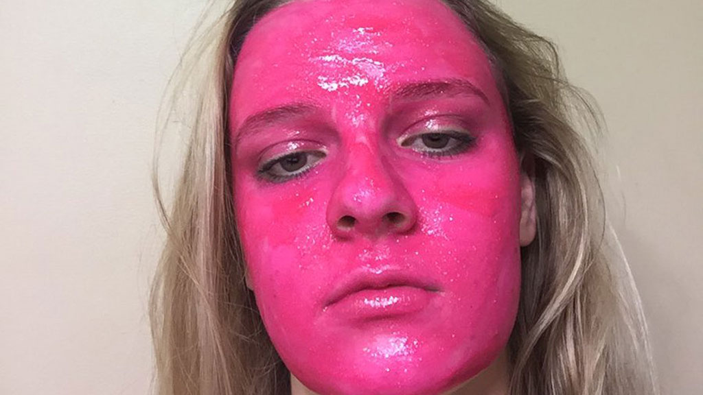Woman accidentally dyes face pink after using poster paint
