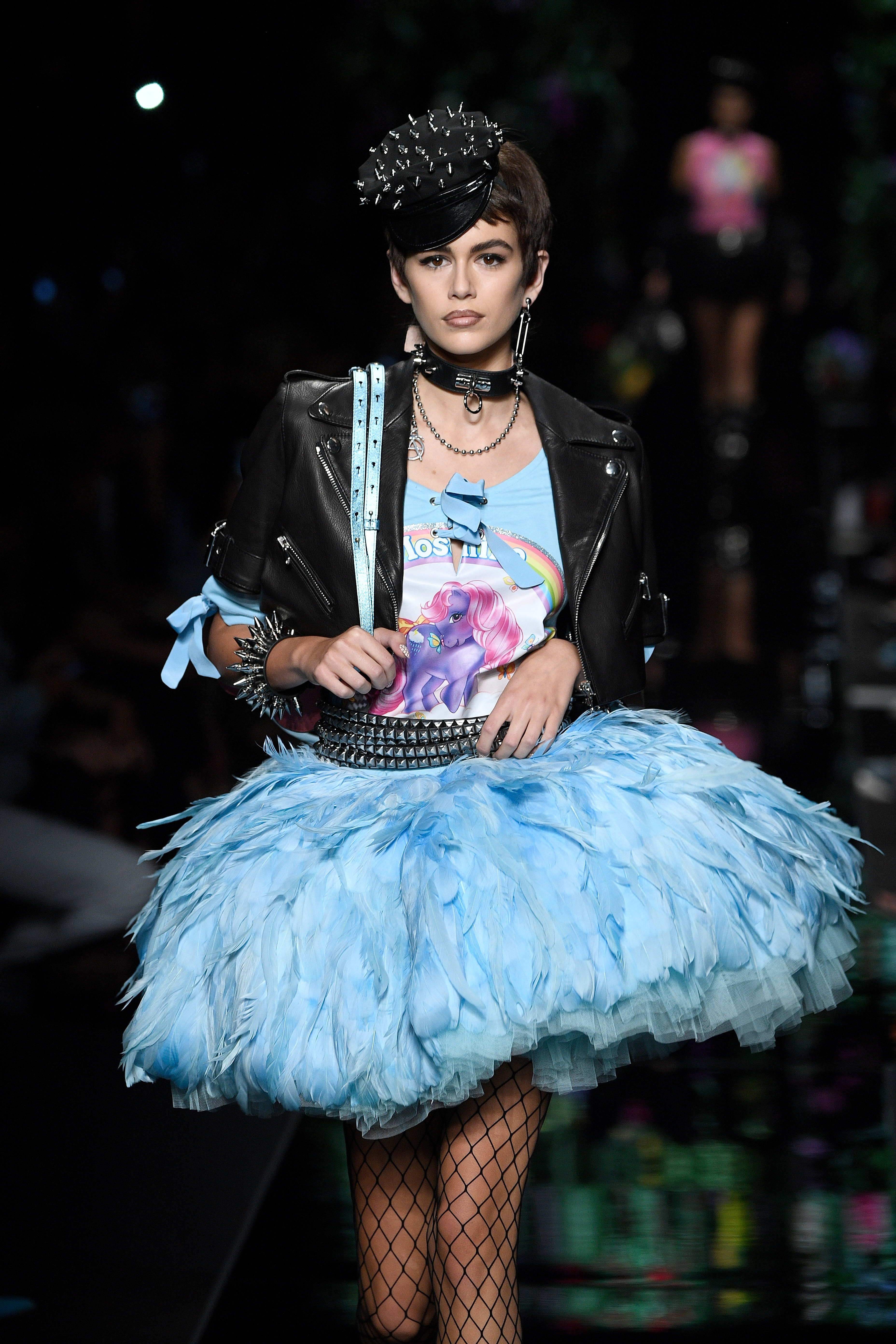"""<p>Moschino's Spring/Summer'18 show at Milan Fashion Week last night had a serious case of déjà vu.</p> <p> <a href=""""http://style.nine.com.au/2017/09/04/11/43/kaia-gerber-16-cindy-crawford"""" target=""""_blank"""" draggable=""""false"""">Model-of -the-moment Kaia Gerber</a> opened the show clad in a leather biker jacket, boots and hat that looked almost identical to the ones worn by her mother, Cindy Crawford, in a famous photograph taken by Peter Lindbergh for <em>Vogue</em> in 1991.</p> <p>If Gerber's outfit wasn't enough of a nostalgic fix, the My Little Pony-inspired creations worn on the runway by Gigi and Bella Hadid, Joan Smalls and Taylor Hill provided a different kind of throwback.</p> <p>Models strutted their stuff in bright, eye-catching tees and sweatshirts with pony prints inspired by the '80s cartoon show. The Pony-powered designs are part of Moschino's creative director Jeremy Scott's limited-edition capsule collection.</p> <p>Balancing out the horsey garments were vibrantly coloured ball gowns and most memorably head-to-toe floral looks worn by Gigi and Gerber that saw the models turn into real-life flower bouquets.</p> <p>Click through to see all the highlights from Moschino's S/S'18 show.</p>"""