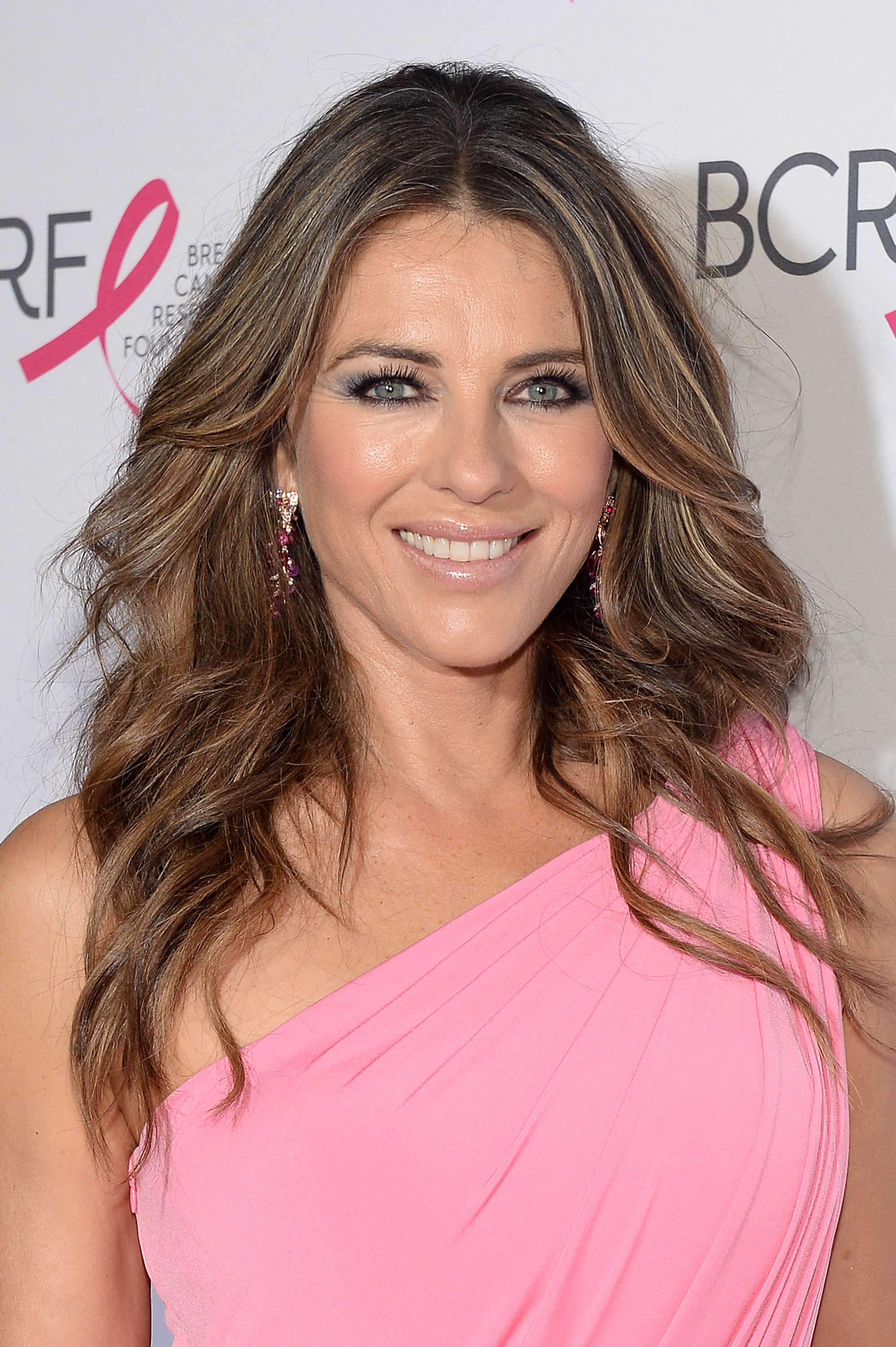 "<p>Elizabeth Hurley wears many hats -- actress, model, bikini designer -- but the role that has long been the closest to her heart is being the Global Ambassador for Estée Lauder's breast cancer campaign, BCA.</p> <p>The<em> Bedazzled</em> star has been the face of the cosmetic giant's global breast cancer charity since signing on as a brand ambassador in the mid '90s.</p> <p>""No one talked about breast cancer in those days. Cancer was a dirty word – it was whispered – as if it were contagious even to say it, my grandmother, who was fabulous and from a large, happy family, didn't talk about it, even to my mother,"" Hurley told <em><a href=""https://www.google.com.au/search?rlz=1C1CHFX_enAU747AU747&q=liz+hurley+dailymail&oq=liz+hurley+dailymail&gs_l=psy-ab.3..0i10k1j0i22i10i30k1.3058.6161.0.6374.21.16.3.0.0.0.298.2374.0j9j3.12.0.dummy_maps_web_fallback...0...1.1.64.psy-ab..7.12.1719...0j0i22i30k1j0i13k1j0i8i13i10i30k1j0i8i13i30k1.0.Shw7GNPdikw"" target=""_blank"" draggable=""false"">Daily Mail UK.</a></em><br /> <br /> ""We found out later she'd had a double mastectomy but we didn't know when she had it; we weren't there for her. Now survival rates are higher and there are better treatments. We've done a good job of spreading awareness. A world that doesn't have breast cancer – or one where you don't die of it – has to be the aim.""<br /> <br /> With October being Breast Cancer Awareness Month and the 25th anniversary of the campaign (it launched in 1992 by Evelyn H. Lauder), Hurley kick-started the celebrations by surprising passengers on a flight from London to New York and passing out pink ribbons over the weekend.</p> <p>Hurley's sky-high deed is the first of many events the actress will participate in to support the Breast Cancer Research Foundation.</p> <p>We here at HoneyStyle have decided to also think pink this October to raise awareness for Breast cancer. Click through to see our favourite beauty products that are donating a portion of their sales to the National Breast Cancer Foundation.</p>"