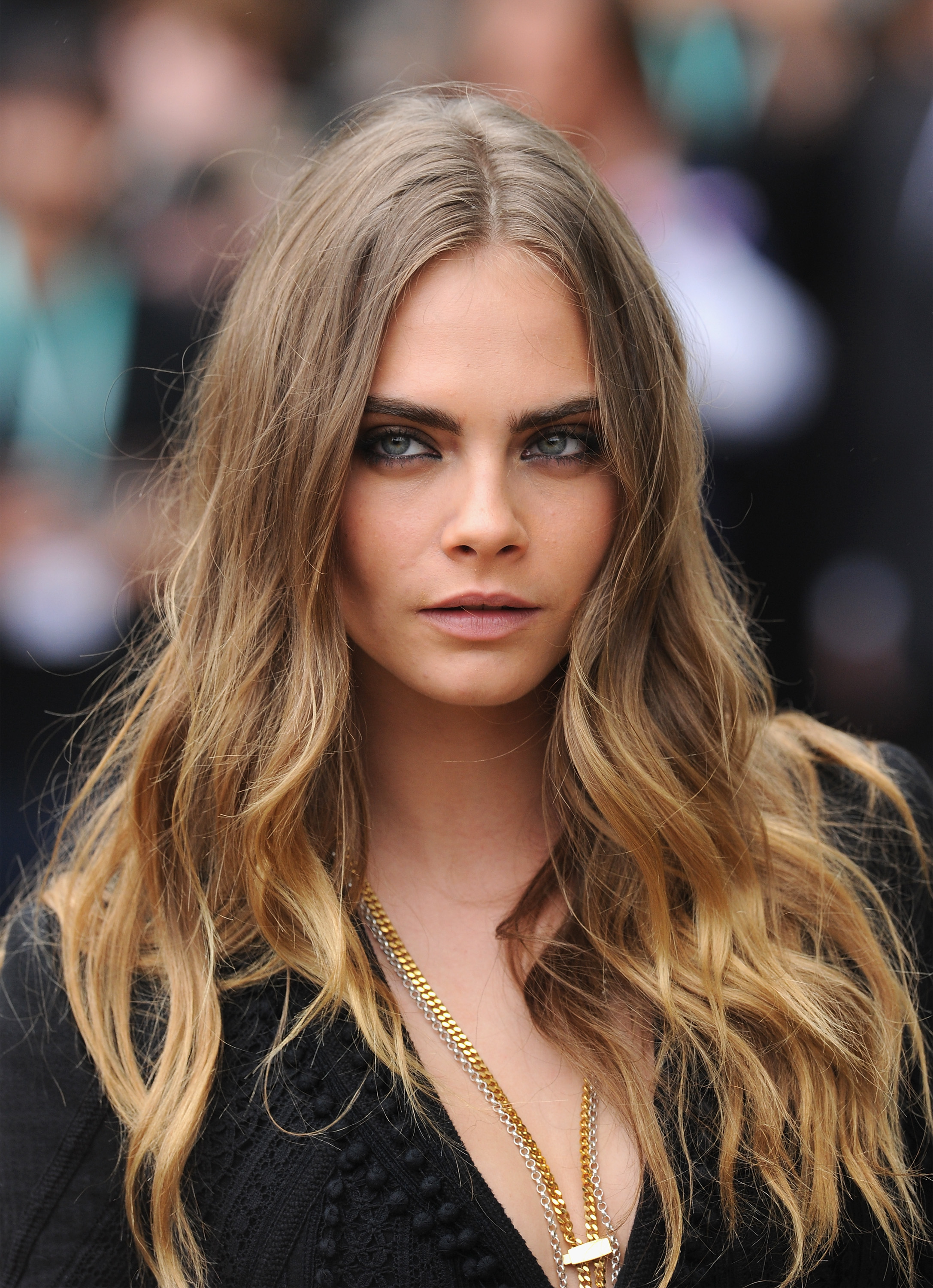 <p>Cara Delevinge has switched it up again and has stepped out as a brunette.</p> <p>The model, actress and author appeared at a launch for her newly-released novel Mirror Mirror with her hair shaped into a sweet pixie cut and dyed a rich hue of chocolate.</p> <p>Cara is something of a hair chameleon having worn her hair in dozens of different shades, styles and cuts in recent years. She's been fairy floss pink, metallic silver and shorn to the scalp.</p> <p>She's even hit the red carpet sporting hand-painted temporary tattoos across her skull, but this is the first time we've seen her rocking a lush brown - at least for nigh on a decade - and we have to say it suits her.</p> <p>The colour makes her tawny, hazel eyes look even more beautiful and it lifts her complexion too. All in all - we approve. Click through to see exactly what we mean and also, revisit some of Cara's more famed hair looks.</p>