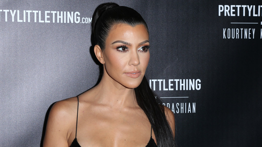 """<p>Kourtney Kardashian's much-awaited fashion line with <a href=""""https://www.prettylittlething.com.au/"""" target=""""_blank"""">Pretty Little Thing</a> has dropped and it is quite something.</p> <p>The range includes 43 separate items including bodycon dresses, jumpsuits, shoes, a jacket and even a diamante choker with her name on it.</p> <p>The colour palette includes black, fuchsia, lime and a floral pattern. There's lipstick pink stiletto ankle boots and a pair of silver strappy heels too. The range is revealing with touches of lace, sequins and even crystal detailing.</p> <p>Every piece is revealing in the extreme - but then this is a Kardashian range so that's hardly surprising. Like the sound of that? Scroll through and see Kourtney modelling her most risque pieces. Maybe buy a couple too.</p>"""