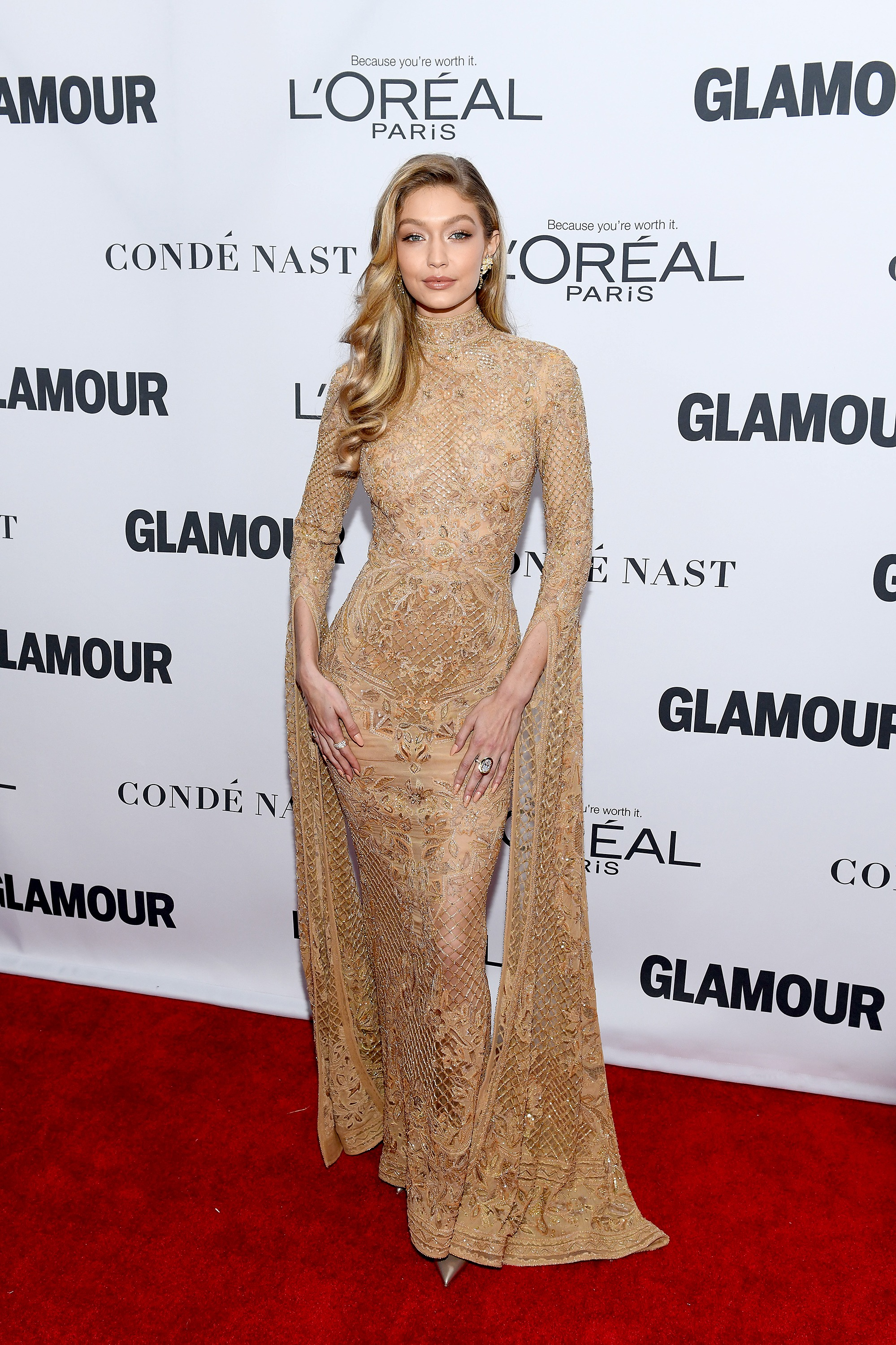 "<p>Gigi Hadid dressed for the occasion at the Glamour Women of the Year event alongside fellow honorees Nicole Kidman and Samantha Bee.</p> <p>The nude-look Zuhair Murad dress clung to the supermodel's frame, delivering sophisticated sensuality while covering more than it seemed to reveal.</p> <p>Sister Bella Hadid and Yolanda Foster were on hand to celebrate Gigi's cover. In the special issue Gigi speaks out about the price of fame. </p> <p>""I believe that a lot of judgmental comments come from people not really having compassion for those they see as public figures,"" Gigi tells <a href=""https://www.glamour.com/inspired/women-of-the-year"" target=""_blank"">Glamour</a>. ""It's frustrating to see people question my actions or integrity based off something as trivial as leaving my apartment building. I'm just doing my best as I move through life, sometimes dealing with relative hardships like everyone else.""</p> <p>While Gigi opted for a gown worthy of the Oscars, many guests embraced the move towards suits, including last year's honoree Ashley Graham.</p> <p>See the best looks here.</p> <p> </p>"