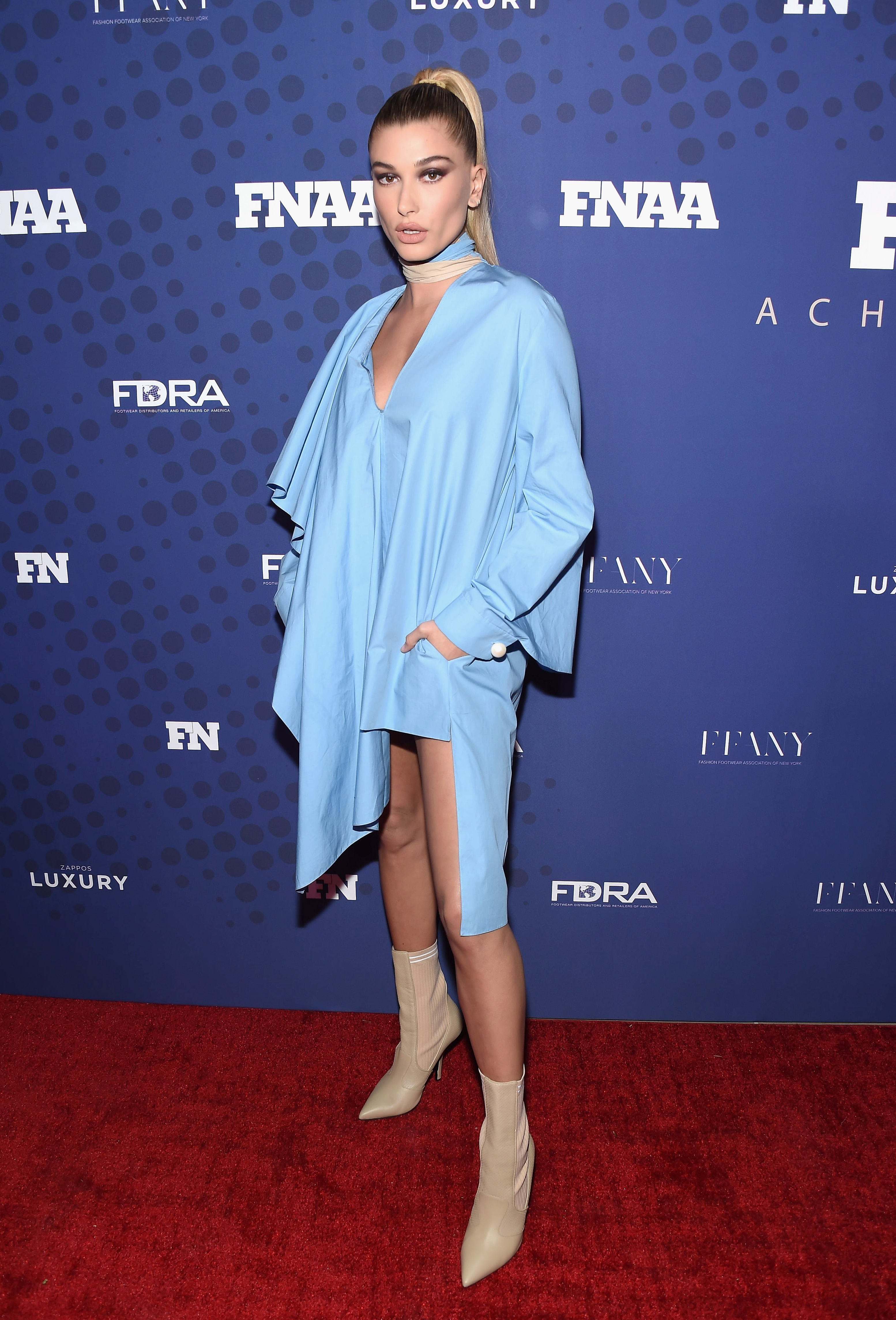 "<p>It was a case of no pants, no problem, for model <a href=""https://style.nine.com.au/hailey-baldwin"" target=""_blank"">Hailey Baldwin</a> who arrived at the FN Achievement Awards in New York wearing a revealing mini Fendi dress. </p> <p>FN stands for <em>Footwear News</em> so Baldwin, who turned 21 last week, was bang on brief, drawing attention to her beige booties.</p> <p>Offering a more urban take on the trouser tossing trend was Justine Skye, wearing the jacket from a sky blue Public School pantsuit.</p> <p>""I think it's cool that people think my style is cool enough to [win an] award,"" Baldwin told <em><a href=""http://footwearnews.com/2017/influencers/awards/hailey-baldwin-fnaa-2017-footwear-news-achievement-awards-style-influencer-of-the-year-461287/"" target=""_blank"" draggable=""false"">Footwear News</a></em>. ""I'm grateful. Street style is such a big part of my job and life, so to be recognised for that is a great opportunity for me.""</p> <p>Don't expect to see Baldwin shirtless away from the red carpet with actor Alec's niece saying that her go-to outfit is: ""Leggings, sports bra and a hoodie.""<br /> <br /> </p>"