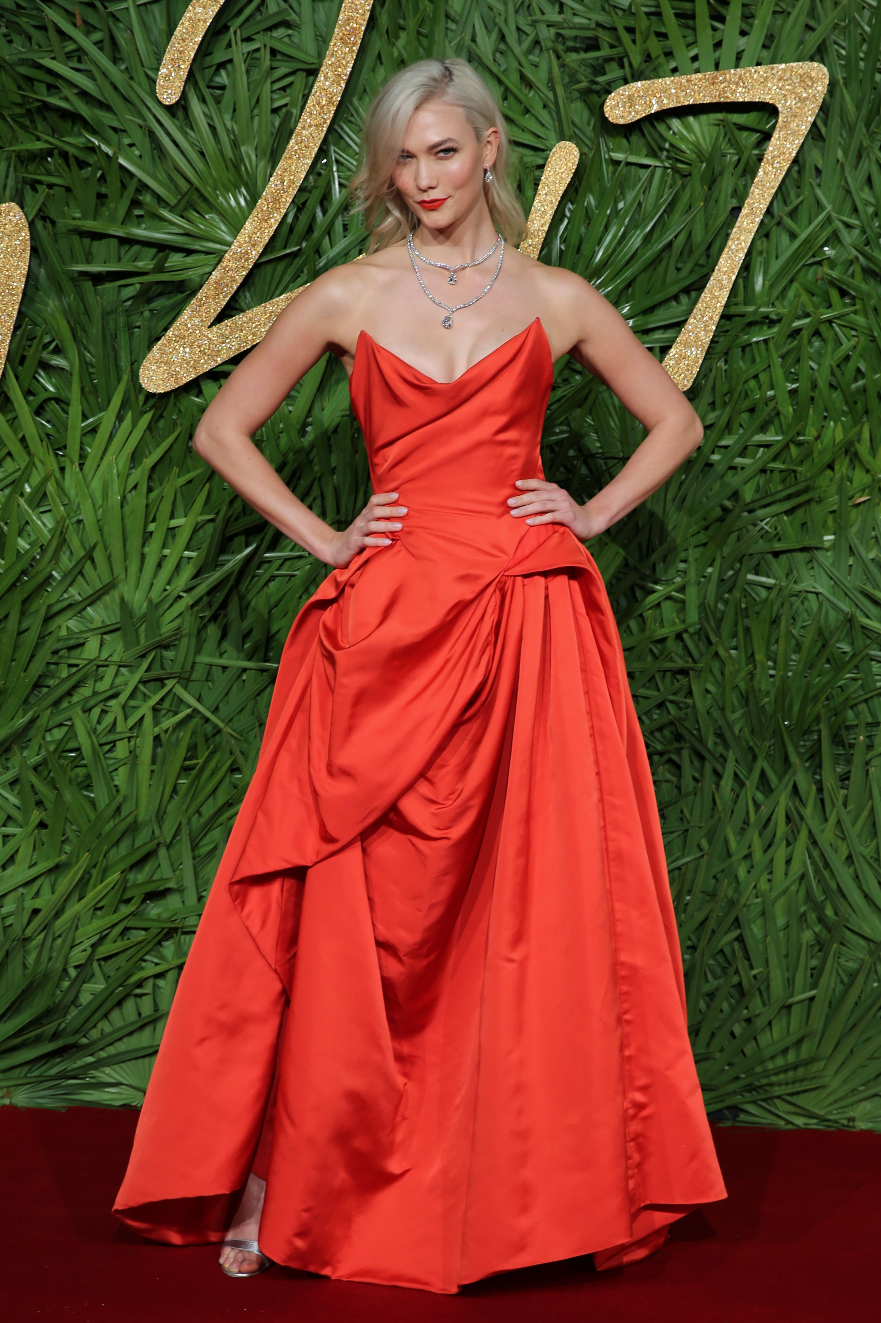 """American supermodel <a href=""""https://style.nine.com.au/karlie-kloss"""" target=""""_blank"""" draggable=""""false"""">Karlie Kloss</a> wore her style credentials on her sleeve as co-host of the <a href=""""https://style.nine.com.au/2017/12/05/08/29/british-fashion-awards-2018"""" target=""""_blank"""" draggable=""""false"""">British Fashion Awards 2017</a>, changing outfits seven times.<br /> Working beside comedian Jack Whitehall, the US Vogue favourite swapped effortlessly from Vivienne Westwood (pictured) to Gucci, to Erdem and even squeezed in a vintage Versace number to honour icon honouree Donatella Versace.<br /> Helping pull the distinct looks together for the 25-year-old was her star stylist Karla Welch, who also works with Ruth Negga, Lorde, Kaia Gerber and Amber Heard.<br /> Welch's favourite look from the night was a fitted blue dress with red gloves from Designer of the Year winner Raf Simons for Calvin Klein.<br /> The hosting gig capped off a stellar year for Kloss who is ranked the seventh-heighest earning model in the world and has 12.6 million social media followers. As well as championing her Kode initiative to get girls into computer coding, Kloss has worked with Swarovski and returned to the runway for Victoria's Secret in Shanghai.<br />"""