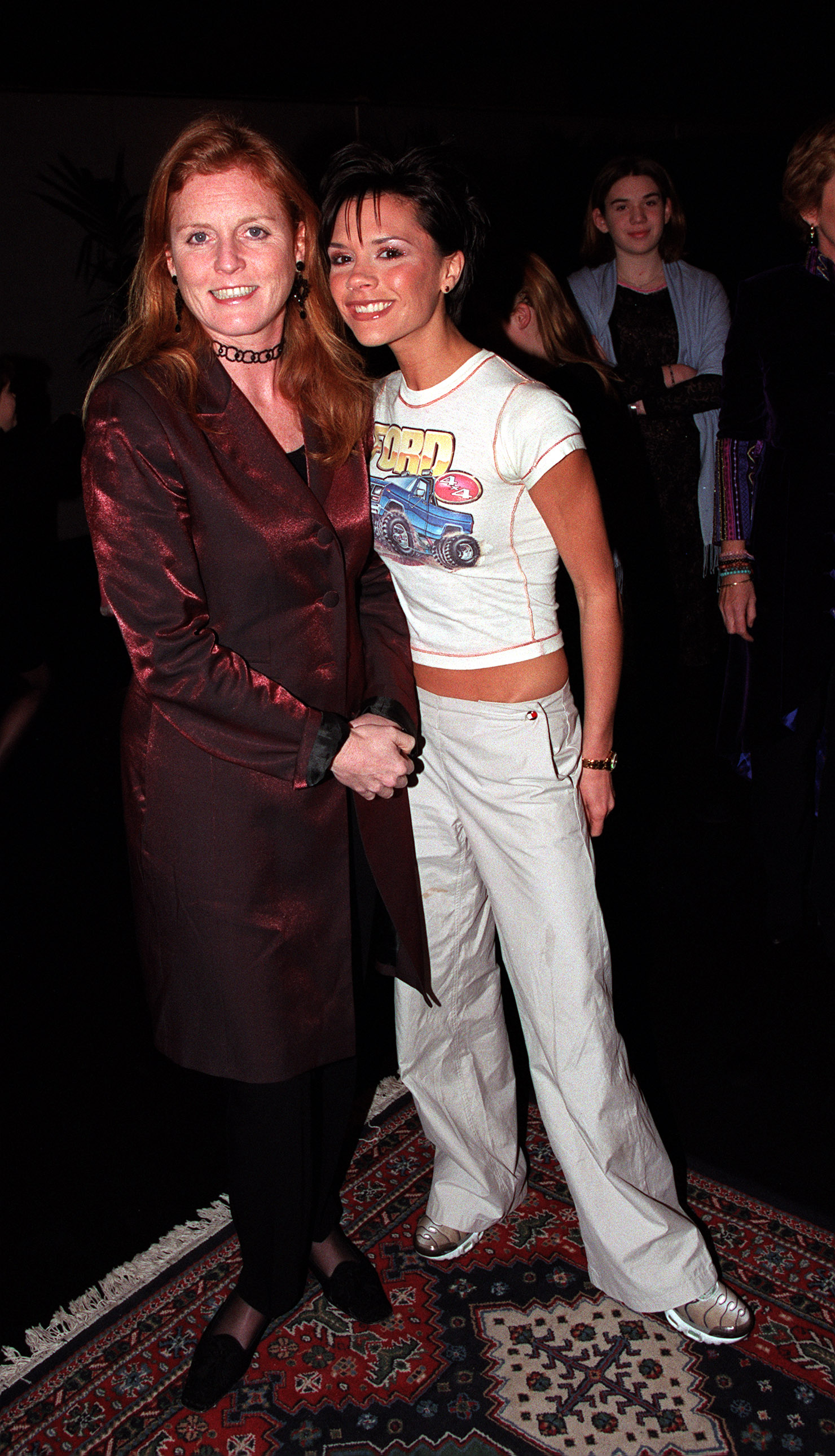 <p>Victoria Beckham with the former Duchess of York, Sarah Ferguson backstage at a Spice Girls concert in London, December 1999</p> <p> </p>
