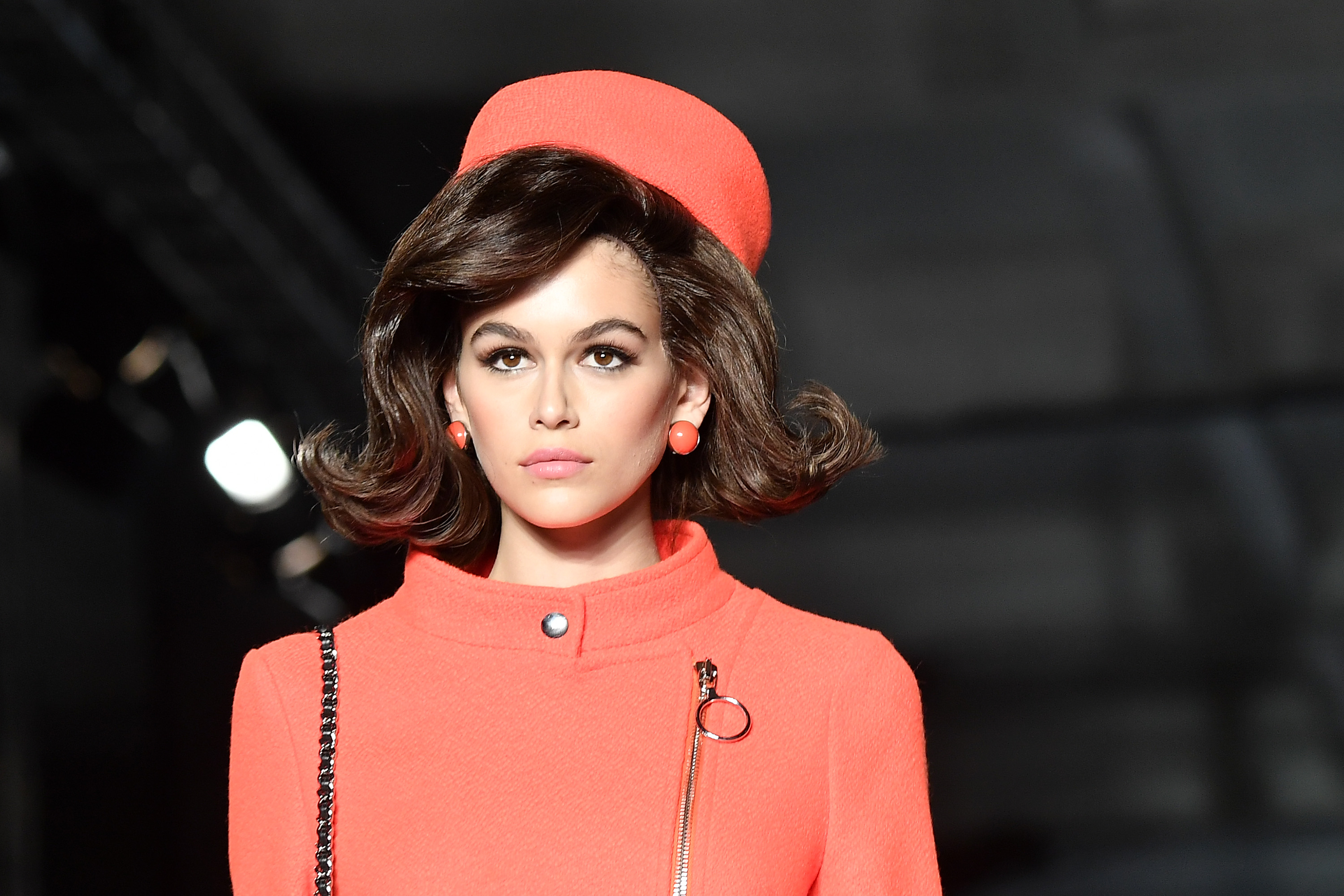 There's no mistaking the timeless appeal and legendary glamour of Jacqueline Kennedy Onassis. Although it's been decades since the late First Lady held court in Washington D.C, her style influence continues to live on. <br> <br> Point in case, Moschino's A/W'18 show at Milan Fashion Week on Thursday.<br> <br> The luxury label's creative director, Jeremy Scott, turned back time as he sent models-of-the-moment Gigi and Bella Hadid and Kaia Gerber down the runway dressed as Jackie O look-alikes.<br> <br> The star-studded line-up -which also included South Sudan-born Aussie model, Duckie Thot, as well as Victoria's Secret angel Joan Smalls – received the complete Jackie O works, from her prim pastel skirtsuits and matching pillbox hats, to her winged cat eye and curvy bob.<br> <br> Scott's take on fashion's favourite first lady and the swinging '60s was quirky, colourful and cool at a time when politics is anything but.<br> <br> Click through to see all the highlights of Moschino's /AW '18 show.