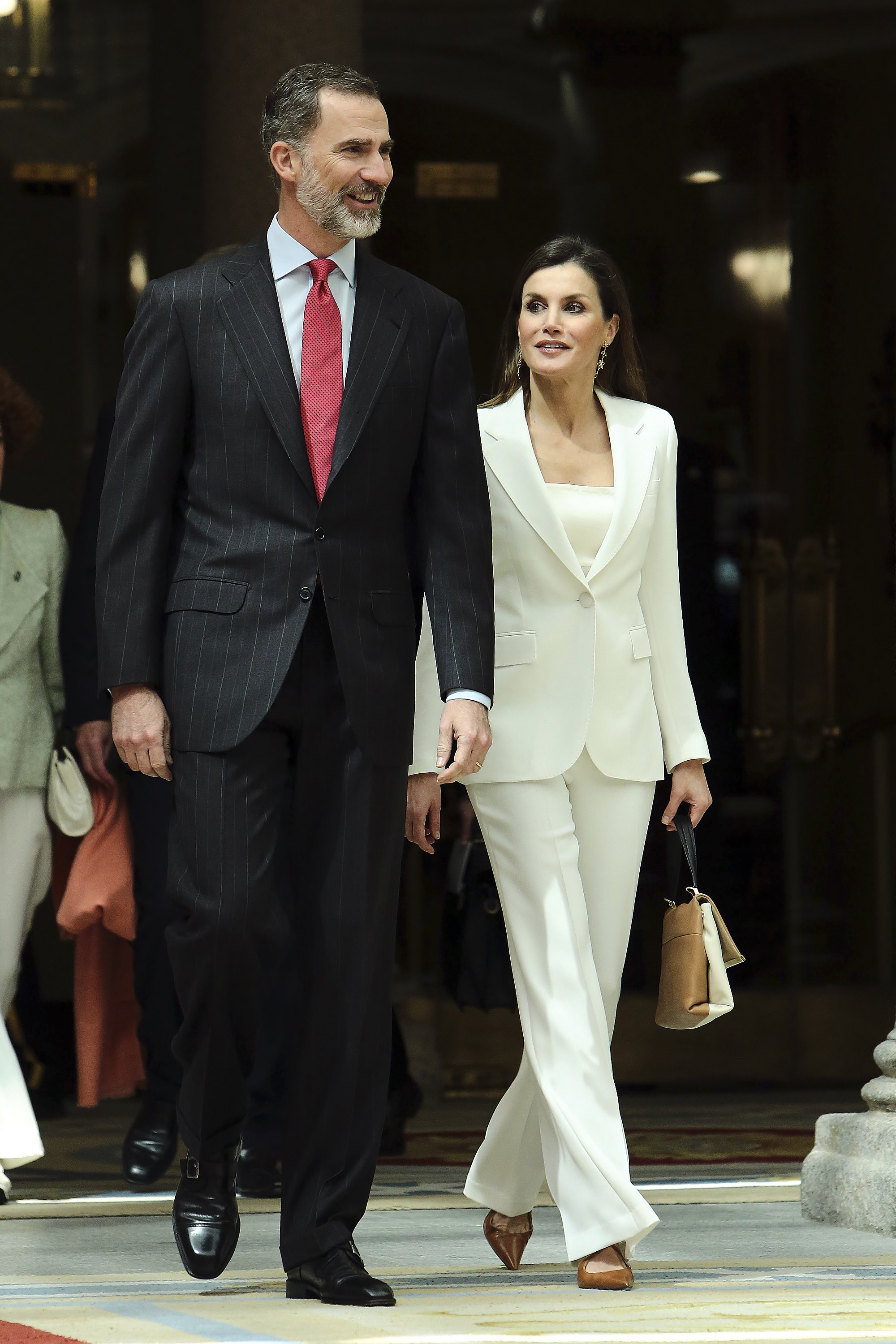 """<p><a href=""""https://style.nine.com.au/2017/07/13/10/26/style_queen-letizia-of-spain"""" target=""""_blank"""" draggable=""""false"""">Queen Letizia of Spain</a> has once again proved she is a <a href=""""https://style.nine.com.au/2017/07/13/10/26/style_queen-letizia-of-spain"""" target=""""_blank"""" draggable=""""false"""">fashion force</a> to be reckoned with.</p> <p>All eyes were on Spain's First Ladyas she upped the sartorial stakes in a slick white pant suit by Carolina Herrera when stepping out with her husband King Felipe VI for an event at the royal palace of El Pardo.</p> <p>The mother-of-twopaired her look with a tan and white Carolina Herrera camelot bag, and pointed tan heels.</p> <p>It's rare for the monarch to step out without garnering fan-fare over her polished style, often mixing high-end designer items from the likes of Alexander McQueen and Altuzarra, with fast-fashion pieces from high-street brands such as Zara and Topshop.</p> <p>Click through to take a look at some of the Spanish royal's most stand-out looks of late…</p>"""