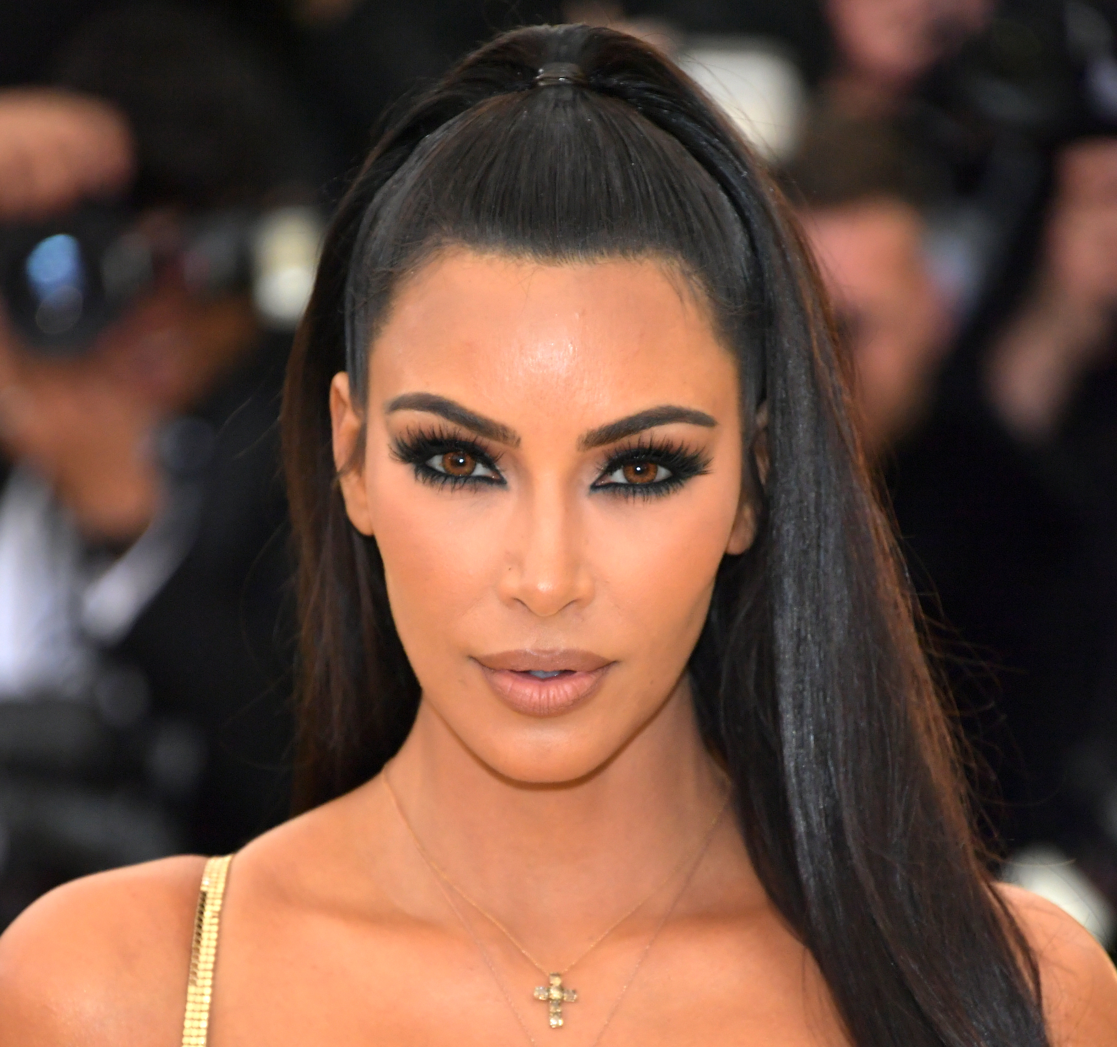"""Despite the unofficial title of being 'The Oscars of fashion', the Met Gala is equally about the boldest and bravest beauty looks. <br> <br> Case in point, Kim Kardashian West.<br> <br> The reality star made a (fashionably) late entrance at this year's celebration <em><a href=""""https://style.nine.com.au/2018/05/08/08/05/met-gala-2018"""" target=""""_blank"""" draggable=""""false"""">'Heavenly Bodies: Fashion and the Catholic Imagination'</a></em>, clad in a show-stopping fitted gold gown courtesy of Atelier Versace.<br> <br> Mrs West's gown may have had the Midas touch, but it was her beauty look that stole the show. <br> <br> While the mother-of-three never fronts up without a full face, this time she took her glam to the next level with the help of her go-to makeup artist, Mario Dedivanovic.<br> <br> Using an array of products from Kardashian's own makeup range, KKW Beauty, he used a mixture of eyeshadows, a brightening powder, crème contour sticks in two different shades, a highlighter and smouldering brown lipstick to give the beauty mogul a '90s supermodel-inspired look.<br> <br> Get the full breakdown of the mother-of-three's beauty look at Dedivanovic's Instagram page @makeupbymario.<br> <br> Click through to see the other stars that put their best face forward at this year's Met Gala."""
