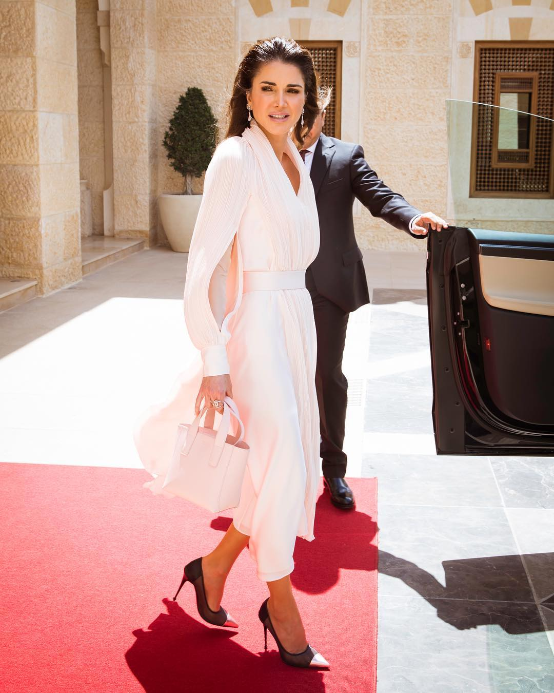 Queen Rania of Jordan has once again claimed Kate Middleton's crown when it comes to being the world's most stylish of royal.<br /> <br /> For an appearance in Amman on Tuesday, the eternally chic Queen opted for a casual look with a sprinkle of polish courtesy of luxury Japanese designer, Adeam. A pair of metallic stilettos and micro handbag from Tom Ford gave the look an edgy finish.<br /> <br /> Whether she's reforming her country's education system or attending an international gala, Her Majesty never fails to deliver a line-up of timelessly elegant outfits that pack a punch.<br /> <br /> Rania's royal wardrobe may be filled with likes of Salvatore Feragamo, Antonio Berardi and Alexander McQueen, but she is also a promoter of Middle Eastern designers such as Elie Saab and Hussein Bazaza.<br /> <br /> Click through to see some of the recent fashion wins of Queen Letizia of Spain.