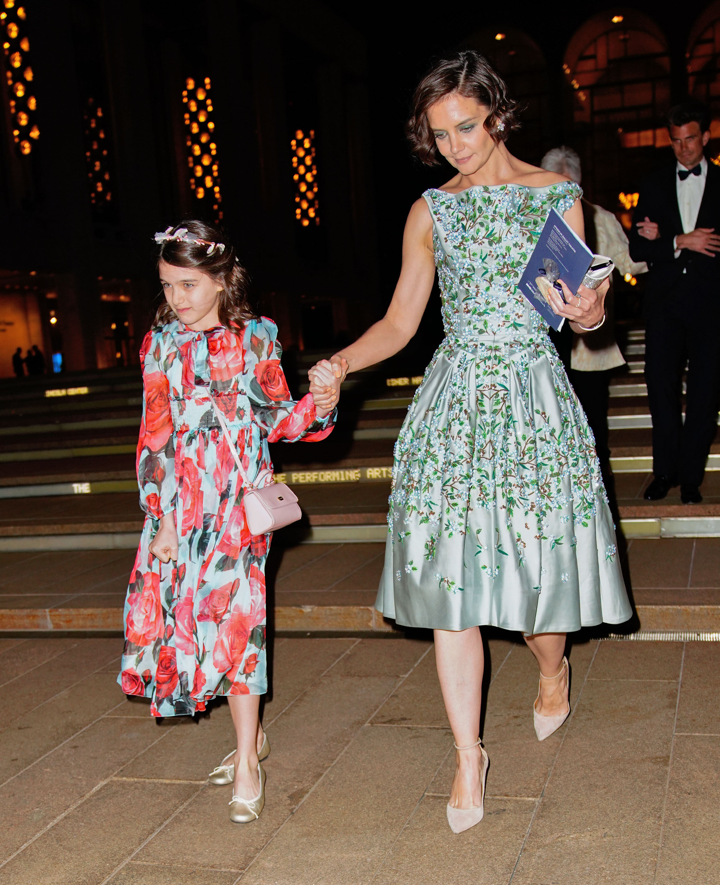 """With a fashion blog named in her honour, <em>Vanity Fair</em> covergirl status and a collection of custom-made Louboutins, Suri Cruise is the reigning queen of fashionable Hollywood offspring.<br /> <br /> So, it comes as no surprise that the 12-year-old daughter of Tom Cruise and Katie Holmes chose to make her debut at the Spring Gala for American Ballet Theatre in New York City, clad in a $1,577 Dolce & Gabbana dress.<br /> <br /> The price point may not be your average 2-for-1 buy at Pumpkin Patch, but it seems relatively tame in comparison to <a href=""""http://https://style.nine.com.au/2017/03/07/08/53/beyonce-blue-ivy-gucci-beauty-beast"""" target=""""_blank"""">Beyonce's daughterBlue Ivy's $32,000 Gucci dress inclinations.</a><br /> <br /> But the tween's best accessory for the night? Her mother.<br /> <br /> Holmes complemented her daughter's floral look with an equally show-stopping flowery gown courtesy of designer, Zac Posen.<br /> <br /> From their matching raven-coloured hair, gamine smiles and penchant for pastels and prints, the mother-daughter duo showed how to make a twinning sartorial statement.<br /> <br /> Click through to see more of Katie, Suri and other famous mother-daughter duos in our celebrity twinning gallery.<br />"""