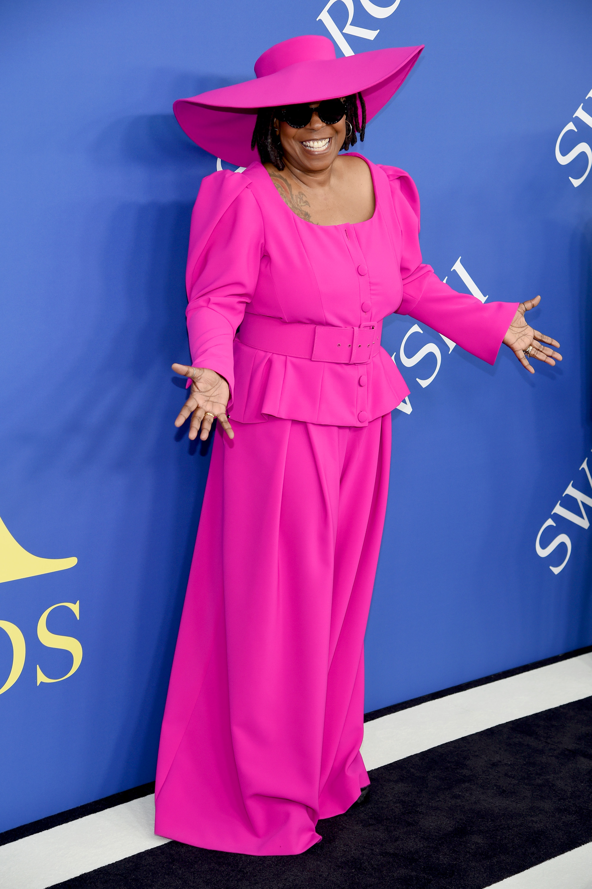 "The CFDA Awards are where designers, stylists, models and muses are honoured by the Council of Fashion Designers of America, but actress and comedian Whoopi Goldberg has taken out the top prize on the red carpet.<br /> <br /> In a head-to-toe fuchsia suit and matching hat by designer and diversity advocate, Christian Siriano, the 62-year-old co-host of <em>The View</em> demonstrated why she may be the fashion world's most underrated icon. The look was powerful, playful and had attitude in spades, much like its wearer.<br /> <br /> But the cherry on top? A pair of black sneakers hidden underneath the suit that ensured the Sister Act star could glide up and down the red carpet with much more ease than her fellow attendees in Manolos and Louboutins.<br /> <br /> This year's CFDA Awards saw supermodel Naomi Campbell take out the Fashion Icon Award, while<a href=""http://https://style.nine.com.au/2018/06/04/14/34/kim-kardashian-cfda-award-style-evolution"" target=""_blank""> Kim Kardashian West is set to receive theinaugural Fashion Influencer honour.</a><br /> <br /> Also gracing the podium tonight is iconic designer Carolina Herrera who will receive the Founder's Award, and <em>British Vogue</em>'s editor-in-chief, Edward Enniful, who will receive the Media Award.<br /> <br /> The CFDA Awards may be slightly more low-key than the Met Gala, but guests such as Cate Blanchett, Ashley Graham and Gigi Hadid deliver a serious high fashion fix.<br /> <br /> Click through to see all the best looks from the 2018 CFDA Awards."