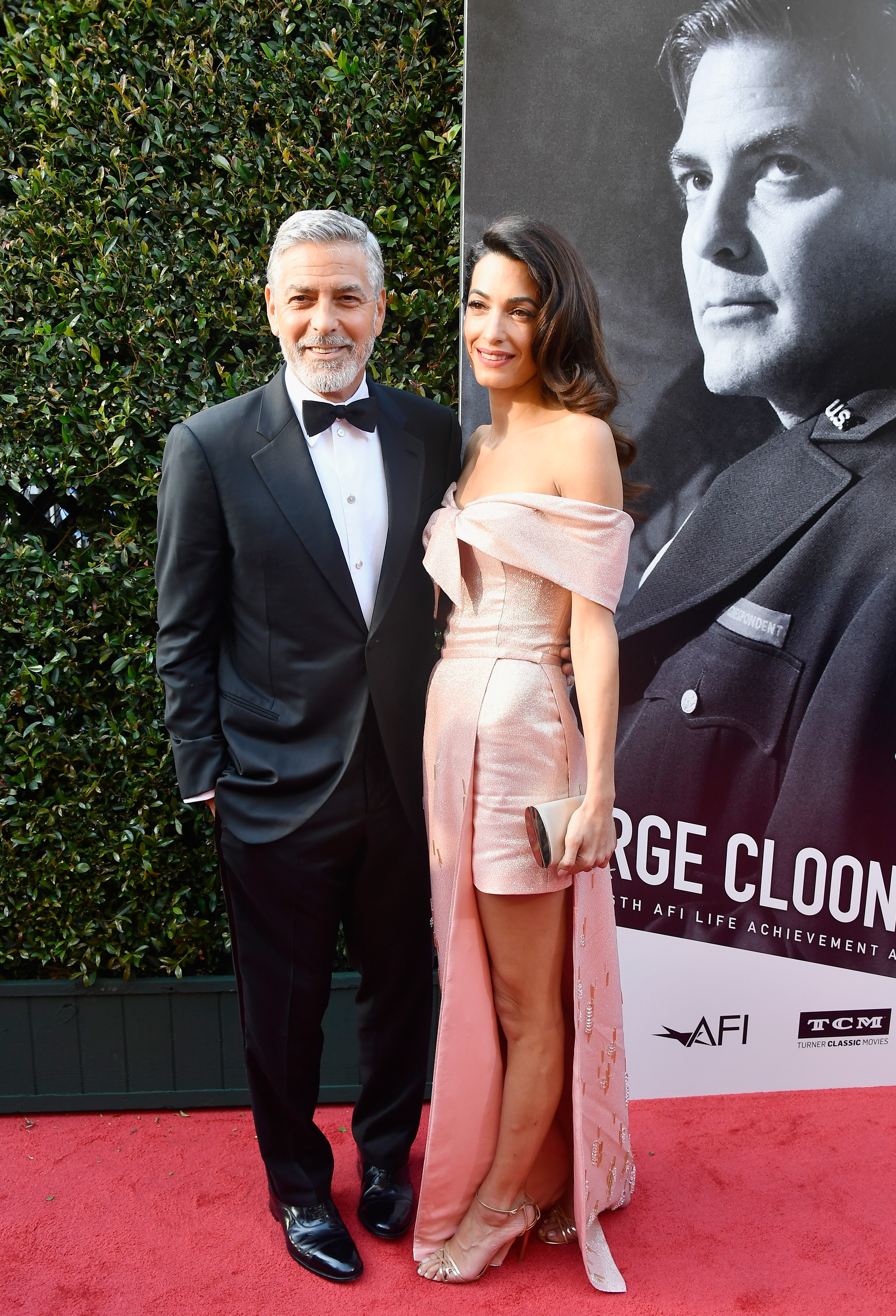 """<p>The A-list have taken to the red carpet to celebrate George Clooney at the American Film Institute's 46th Life Achievement Award Gala.</p> <p>The actor was honoured for his contribution to the film industry, and there was no mistaking the night was all about Clooney and his wife,<a href=""""https://style.nine.com.au/2018/04/06/13/51/amal-clooney-trench-coat-megahn-markle"""" target=""""_blank"""" draggable=""""false""""> Amal.</a></p> <p>George in aclassic tuxedo, while Amal shone in a metallic pink off the shoulder gown, the pair demanded attention from the moment they arrived, cementing their place as the power couple they are.</p> <p>They were joined by a bevvy of Hollywood stars such as Jennifer Aniston who arrived with bestie Courteney Cox, and Cate Blanchett, who lifted the style stakes once again in Aouadi Paris.</p> <p>Click through to take a look at the night's sartorial standouts.</p> <p></p> <p></p> <p></p> <p></p>"""