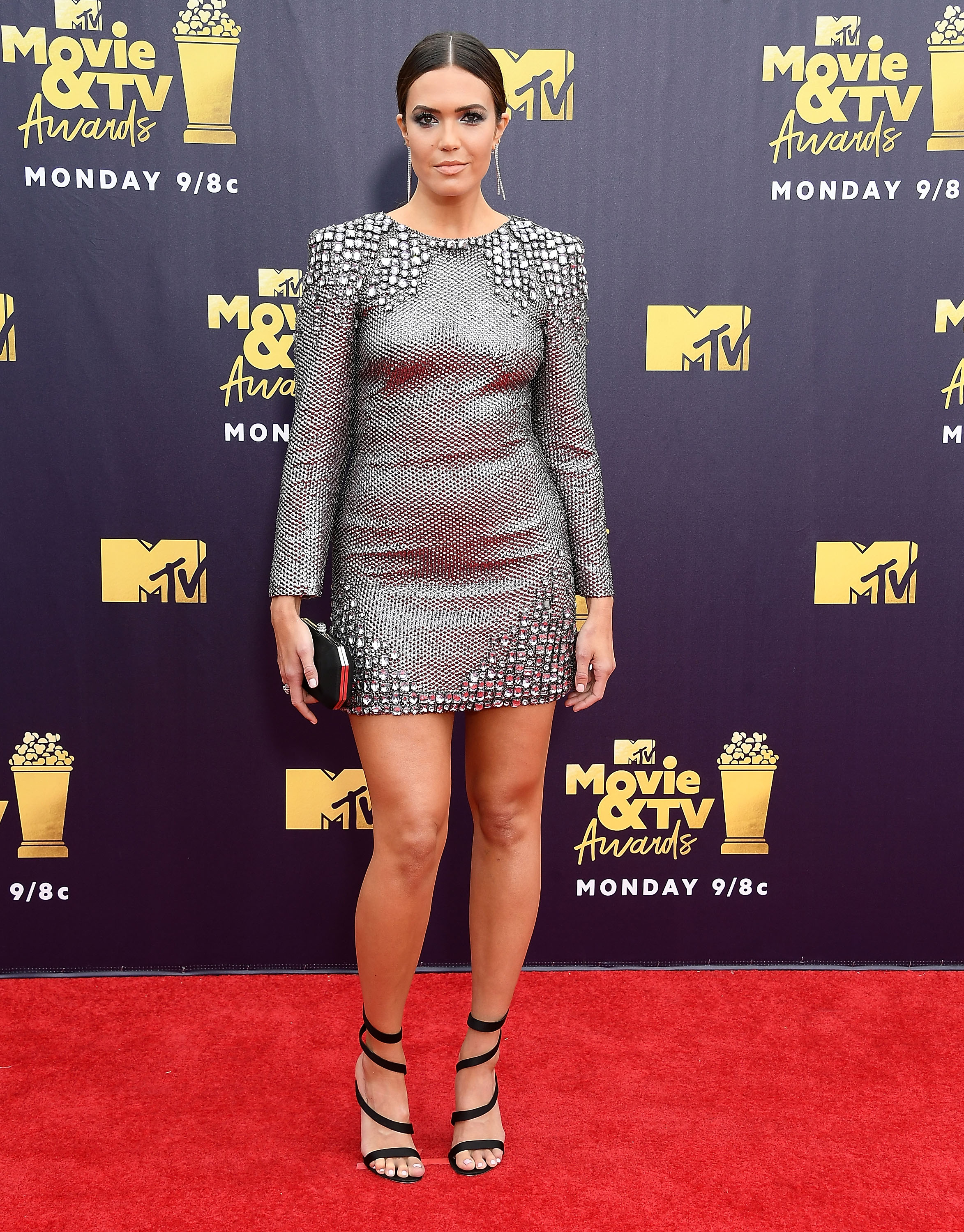 "<p>The stars have brought their sartorial A-game to the 2018 MTV Movie and TV Awards red carpet in Los Angeles.</p> <p>Turning heads like only <a href=""https://style.nine.com.au/2018/06/14/13/57/kim-kardashian-blue-hair-yeezy-hair"" target=""_blank"" draggable=""false"">Kim Kardashian-West</a> can, the beauty mogul, who brought her mum Kris Jenner along for a girls night out, rocked cornrows and a white bandeau top with a curve-hugging, silver skirt with a thigh-high slit by Versace.</p> <p>But Kardashian-West wasn't the only A-lister who stood out on the red carpet. <br /> <br /> <a href=""https://style.nine.com.au/2017/09/14/14/39/style_mandy-moore-hair-comeback"" target=""_blank"" draggable=""false"">Mandy Moore</a> channelled her inner JLo in a metallic mini dress by Alberta Ferretti, while Zendaya wowed in a structured mini dress with an exaggerated skirt by August Getty Atelier, and actress Olivia Munn put her sartorial stamp on a plunging emerald green velvet jumpsuit by Galvan London.</p> <p>Click through to take a look at the most-talked about looks of the night.</p>"