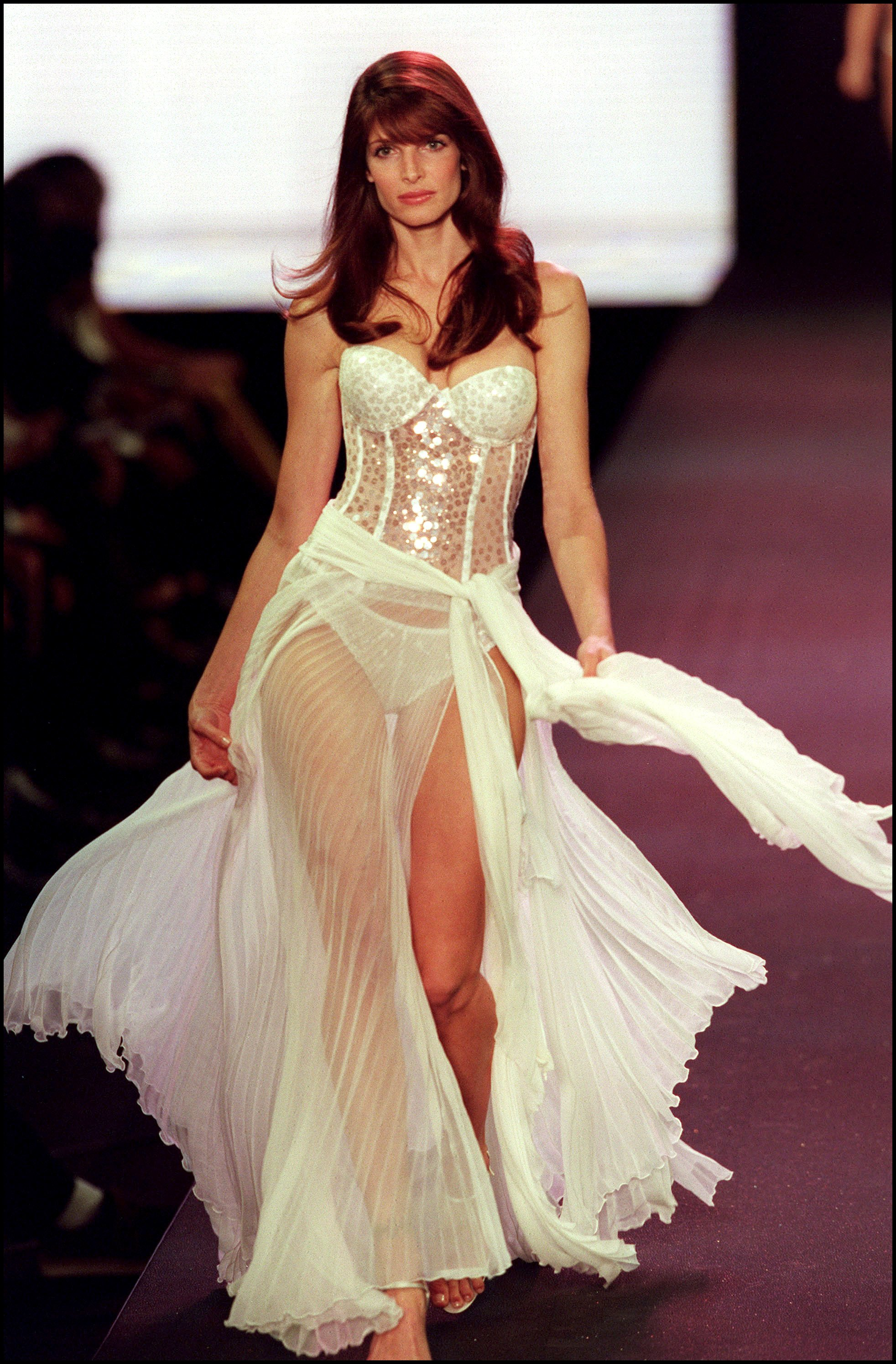 "<p>The <a href=""https://style.nine.com.au/2018/05/04/10/22/rihanna-vogue-fashion-style"" target=""_blank"" draggable=""false"">Victoria's Secret fashion show </a>has become one of the most anticipated events on the fashion calendar.</p> <p>From humble beginnings at New York's Plaza Hotel in 1995 where <a href=""https://style.nine.com.au/2018/02/20/09/19/candice-swanepoel-swimwear"" target=""_blank"" draggable=""false"">models strutted their stuff</a> down the catwalk with cardigans and handbags, the show has involved into a world-class spectacular.</p> <p>20 years on, hotel venues have been swapped for stadiums in Cannes, Paris, Miami and Shanghai, cardigans have been thrown out for 40-pound Angel wings, and handbags ditched in favour of $2 million dollar diamond encrusted bras.</p> <p>And then there's the audience. The televised event is watched by an average of 6.6 million people each year. All tuning in to catch a glimpse of the glamorous, glittering Angels.</p> <p>Walking in the lingerie giant's show is the holy grail for models, getting picked is like being handed the golden ticket. It puts little-known models on the map and sky-rockets careers to supermodel status.</p> <p>Tyra Banks, Heidi Klum, and Gisele Bündchen are all Victoria's secret alumni and there's a new breed of angels such as the likes of Gigi Hadid and Kendall Jenner making their mark and creating their own iconic show moments.</p> <p>Click through to take a look at some of the standout moments from the fashion show over the last 20 years.</p>"