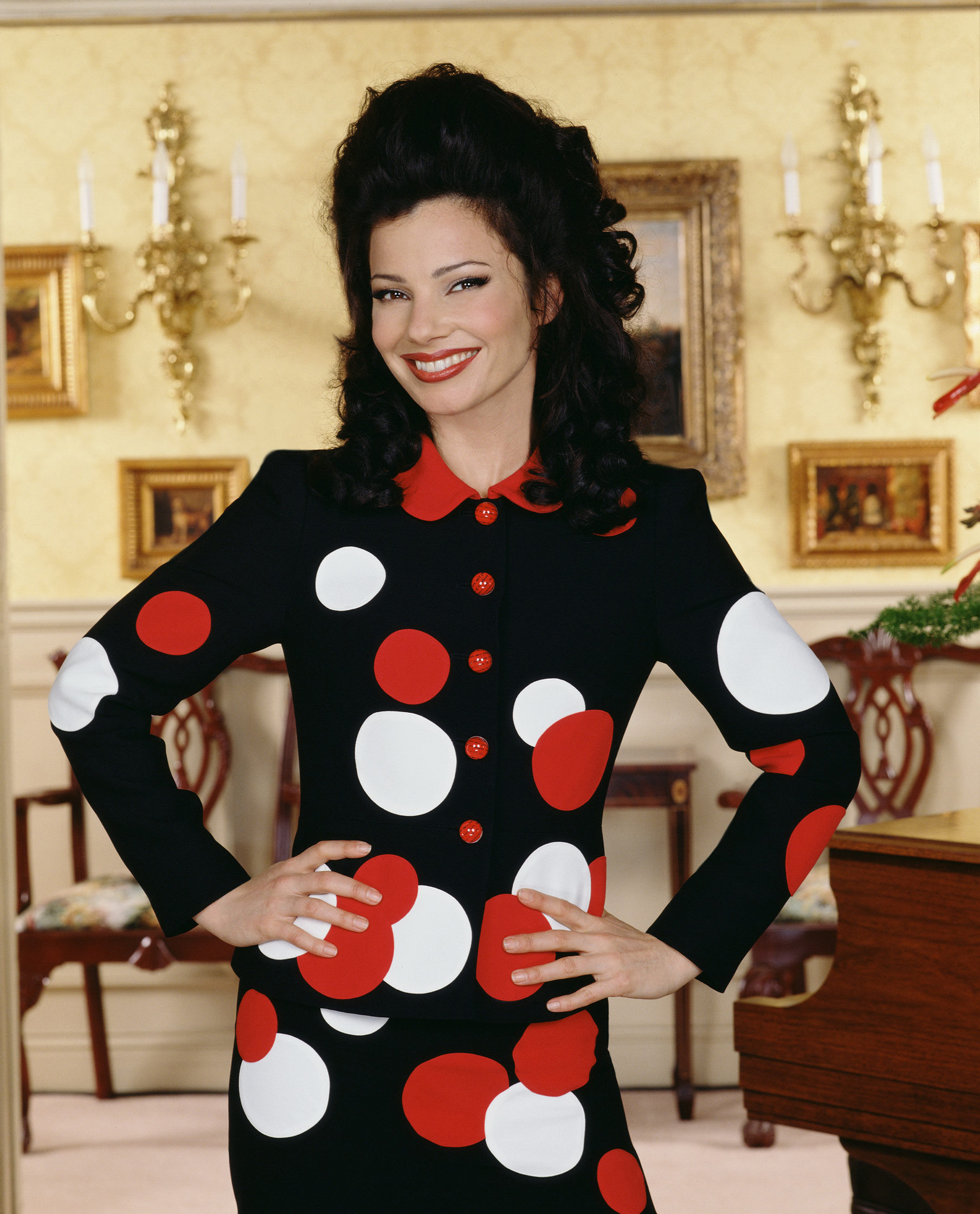 "Hold onto your plaid mini-skirt and bouffant hairdo, one of television's most fashionable (and funniest) characters is set to make a comeback.<br> <br> Actress Fran Drescher, who played the beguiling and bemusing Fran Fine on CBS'S <em>The Nanny</em> from 1993-1999, has revealed that she's ""in talks"" to bring the hit sitcom back to life nearly 20 years after the series finale aired. Oy!<br> <br> ""We're talking about it. Peter (executive producer) and I are talking about it,"" Drescher told <em><a href=""https://www.etonline.com/fran-drescher-says-nanny-revival-could-be-really-good-after-teasing-big-announcement-exclusive"" target=""_blank"" draggable=""false"">Entertainment Tonight.</a></em> ""We're working on a very big project. It's going to be very exciting for the fans, but I'm not at liberty to announce it yet. But it's gonna be big.""<br> <br> While this news is enough to make us want to jump up and down on Sylvia's plastic covered couch, it's also the perfect time to look back at the defining style of fashion's favourite nasal-voiced clothes horse. After all, this is the woman who was wearing red whilst everyone else was in tan.<br> <br> From her ability to mix Moschino and Mugler with a bargain buy from Loehmann's, Fine was one of the small screen's original sartorial risk-takers.<br> <br> Fine's fashion legacy is so memorable it's even spawned it's own Instagram page, <a href=""http://https://www.instagram.com/whatfranwore/?hl=en"" target=""_blank"" draggable=""false"">@WhatFranWore</a>, an account that chronicles, well, the whole megillah of her closet: tight skirt suits and waist-flaunting cropped jackets from Dolce & Gabbana, Todd Oldham and Versus Versace.<br> <br> ""We wanted to make that character be a clotheshorse, because I wear clothes so well, and we understood that television is a visual medium,"" Drescher told <em><a href=""https://www.vogue.com/article/what-to-wear-to-passover-seder-the-nanny-fran-drescher-style"" target=""_blank"" draggable=""false"">US Vogue</a></em> in 2016. <br> <br> ""So it was important for us that she be able to look sexy and dress fun and, you know, just be a surprise in every way.""<br> <br> Click through to revisit some of Fran Fine's most fashionable moments."