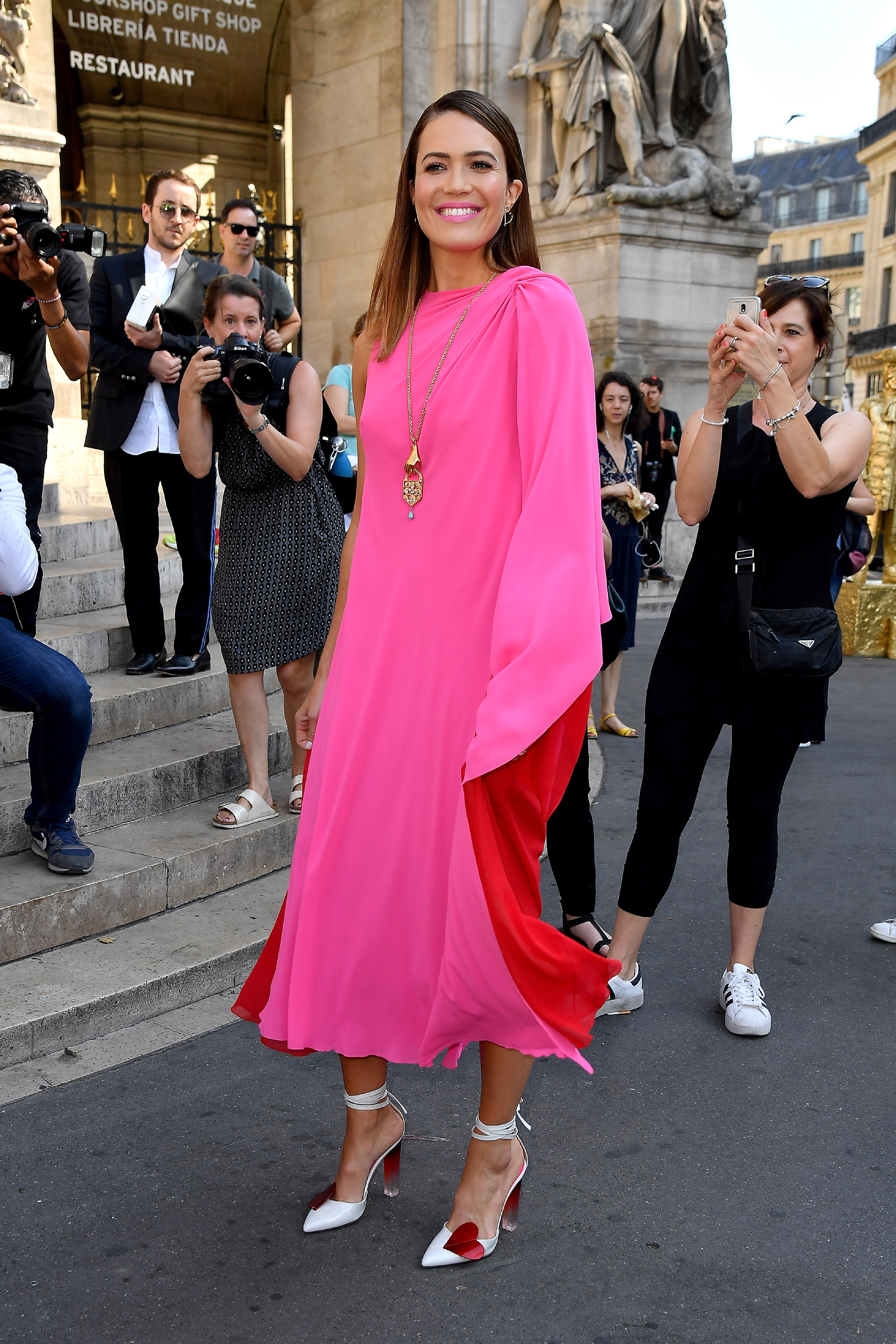 """Paris Haute Couture Fashion Week -- a week-long extravaganza where <a href=""""https://style.nine.com.au/2016/11/28/10/01/iconic-celebrity-hairstyles"""" target=""""_blank"""" title=""""celebrities"""">celebrities</a> and high fashion come together -- is in full flight, but the made-to-measure creations may have stiff competition in actress and singer, Mandy Moore.<br /> <br /> The <em>This is Us</em> star has taken the Parisian city by storm, appearing in the front row at Dior, Schiaparelli, Ralph & Russo and a special event hosted by Versace, in several show-stopping looks that have commanded the attention of the local paparazzi.<br /> <br /> From her first appearance in a hot pink and red frock at the iconic Haute Couture house created by Elsa Schiaparelli, to her rocker stylings at Dior, the 34-year-old is proving herself as a fashion force to be reckoned with.<br /> <br /> Although Moore may be the breakout style star of this year's Haute Couture Fashion Week, Katie Holmes, <a href=""""http://https://style.nine.com.au/2018/07/02/11/35/uma-thurman-miu-miu-runway-kate-bosworth-naomi-campbell"""" target=""""_blank"""" title=""""Kate Bosworth"""">Kate Bosworth</a>, Karlie Kloss and Australian actress, Melissa George, have given her a good run for her money.<br /> <br /> Click through to see all the best celebrity style moments from Paris Haute Couture Fashion Week."""