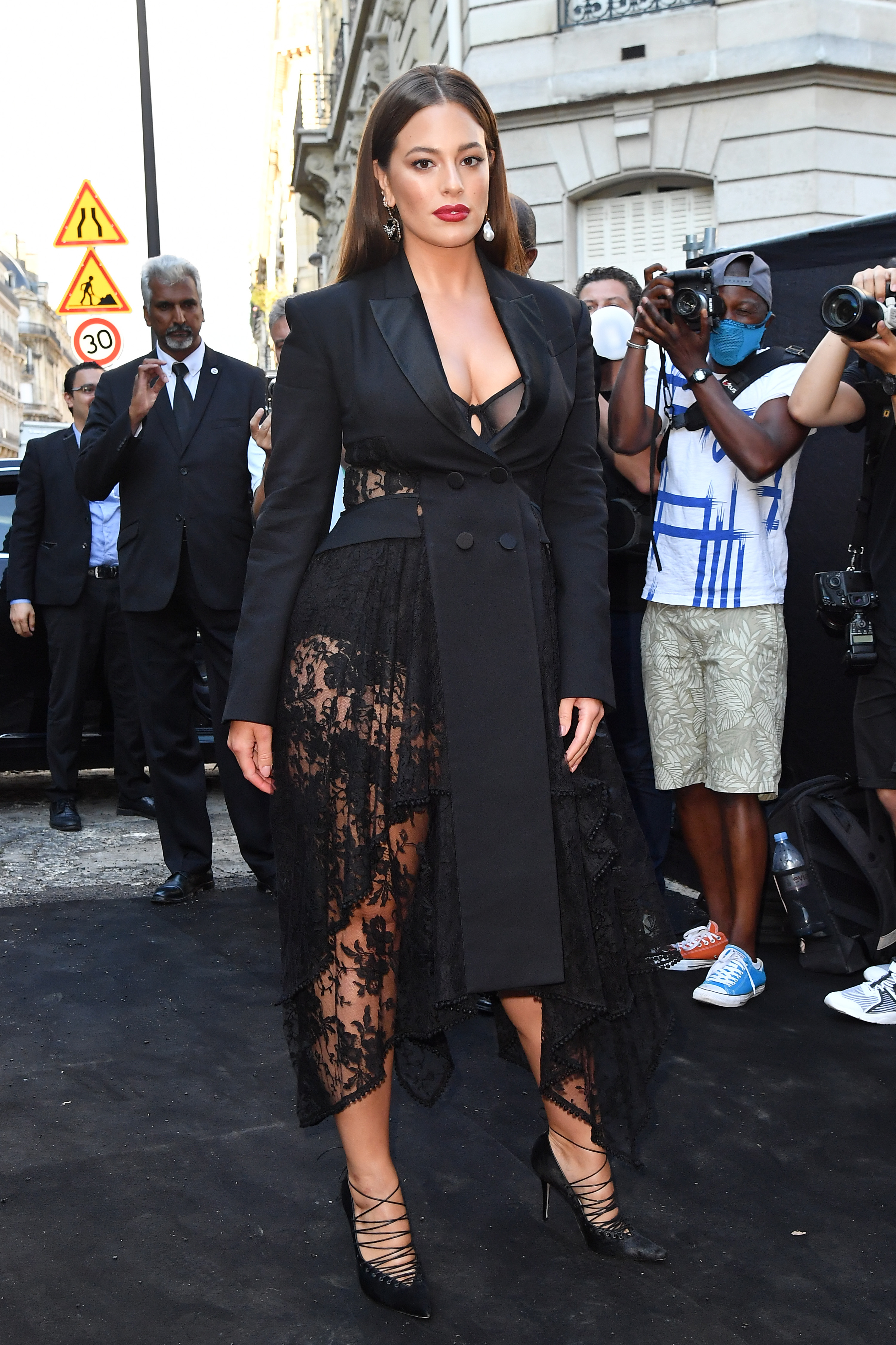 """No further evidence is required that lace is back in a big way than Ashley Graham steaming up the sidewalks of Paris on Wednesday.<br /> <br /> <a href=""""https://style.nine.com.au/2018/01/25/09/28/ashley-graham-revlon-beauty-campaign-plus-size"""" target=""""_blank"""" title=""""The 30-year-old supermodel"""">The 30-year-old supermodel</a> attended a gala hosted by <em>Vogue Paris,</em> where her sheer lace ensemble from Alexander McQueen stole second glances as she joined other high-profile attendees such as Naomi Campbell, Emily Ratajkowski, Kaia Gerber and Virgil Abloh at the Palais Galliera.<br /> <br /> Considering lace's connotations with romance and allure, it's not surprising Graham, <a href=""""https://style.nine.com.au/ashley-graham/3"""" target=""""_blank"""">the first plus-size model to pose for the cover of <em>Sports Illustra</em>ted</a>, has made it a fixture in her wardrobe.<br /> <br /> """"I know my curves are sexy and I want everyone else to know that theirs are too,"""" Graham told<em><a href=""""https://www.usmagazine.com/stylish/news/sports-illustrated-plus-size-model-ashley-graham-2015-swimsuit-issue-201542/"""" target=""""_blank"""" title="""" US Magazine.""""> US Magazine.</a></em><br /> <br /> """"There is no reason to hide and every reason to flaunt.""""<br /> <br /> Lace slipped from the spotlight in recent decades, derided as 'dowdy', but Graham and <a href=""""https://style.nine.com.au/2017/10/11/13/43/duchess-of-camrbidge-kate-wears-temperley-lace-dress-buy-shop-ootd"""" target=""""_blank"""" title=""""the Duchess of Cambridge"""">the Duchess of Cambridge</a> are part of a new breed of style icons bringing it back into the spotlight.<br /> <br /> With winter in full swing, there is no time like the present to add a little lace to your cool weather attire.<br /> <br /> For the beginners, consider adding a bralette or slip underneath your winter coat, or for the bold and daring, go full-length in a gown or matching co-ords.<br /> <br /> Click through to find a piece that is right for you.<br /> <br />"""