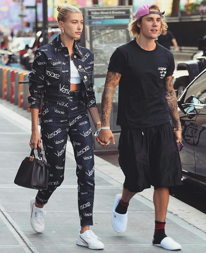 """The Insta generation's model and musician power couple, Hailey Baldwin and Justin Bieber, made a strong case for co-ordinated couple dressing over the weekend.<br /> <br /> The duo, <a href=""""https://thefix.nine.com.au/2018/07/09/06/35/justin-bieber-and-hailey-baldwin-are-engaged"""" target=""""_blank"""" title=""""who reportedly got engaged in Jamaica last night"""">who reportedly got engaged in Jamaica last night</a>, both turned to navy and white for an off-duty trip to New York City.<br /> <a href=""""https://style.nine.com.au/2018/02/26/09/02/dolce-gabbana-autumn-winter"""" target=""""_blank""""><br /> The Dolce & Gabbana muse</a> stuck to her usual preference for <a href=""""https://style.nine.com.au/2018/06/28/13/08/logo-clothes-designer-fashion-beyonce-ariana-grande"""" target=""""_blank"""" title=""""streetwear with a hefty price tag"""">streetwear with a hefty price tag</a>, stepping out in a logo heavy cropped denim jacket and matching jeans from Versace. A pair of gold hoop earrings and Fendi purse gave the look a glamorous finish.<br /> <br /> The Sorry singer kept things in casual in a navy black t-shirt, matching shorts and a different kind of footwear – white hotel slippers.<br /> <br /> If the engagement rumours are true, Bieber and Baldwin could prove to be<a href=""""https://style.nine.com.au/2018/06/22/09/11/louis-vuitton-menswear-spring-summer-19"""" target=""""_blank"""" title="""" slick streetwear's most powerful pair.""""> slick streetwear's most powerful pair.</a> The 21-year-old niece of Alec Baldwin has long made tight leggings, cropped tops, bomber jackets and sneakers a key part of her signature look.<br /> <br /> While Bieber's penchant for basketball jerseys, slouchy gym pants and baseball caps have been essential in transforming his look from teenage protégée to pop icon.<br /> <br /> Whether they're Hollywood superstars, sport stars or fashion industry powerhouses, many style-savvy A-list couples haven't been afraid to make a splash in match matchy attire.<br /> <br /> Click through to see the A-"""