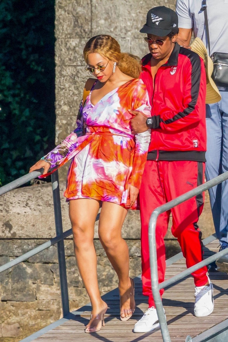 "Jay- Z and Beyoncé are unrivalled when it comes to making a <a href=""https://style.nine.com.au/2017/07/20/15/34/couple-dressing-blake-lively-ryan-reynolds"" target=""_blank"" title=""joint sartorial statement."">joint sartorial statement.</a><br /> <a href=""https://style.nine.com.au/2018/07/09/14/01/kourntey-kardashian-sideboob"" target=""_blank""><br /> Currently in Italy</a> in the middle of their On the Run II tour, the Carters took some time off over the weekend to turn the serene streets of Lake Como into a catwalk.<br /> <br /> Even off-duty, the Single Ladies singer refuses to turn it down a notch, stepping out in a silk floral wrap dress from MSGM and Manolo Blahnik PVC mules. A pair of diamond earrings and gold sunglasses gave the outfit a polished finish.<br /> <br /> Jay Z also put his sartorial foot forward in a red and black velour tracksuit from Puma.<br /> <br /> The two-day mini break may be the last time the power pair take some time off for quite some time. They have just been announced as the headline act for the Global Citizen Festival in South Africa, a celebration to be held in December to honour the 100th anniversary birth of Nelson Mandela.<br /> <br /> Joining Jay and Bey onstage will be Chris Martin, Usher, Pharrell Williams, Ed Sheeran and Eddie Vedder. <br /> <br /> It may be a while before they turn it up in the style stakes in Johannesburg, so in the meantime we have selected of 10 of our favourite style moments from Jay Z and Beyoncé from over the years.<br /> <br /> From their days of wearing double denim in the early '000s to the high-voltage designer looks they are regularly"