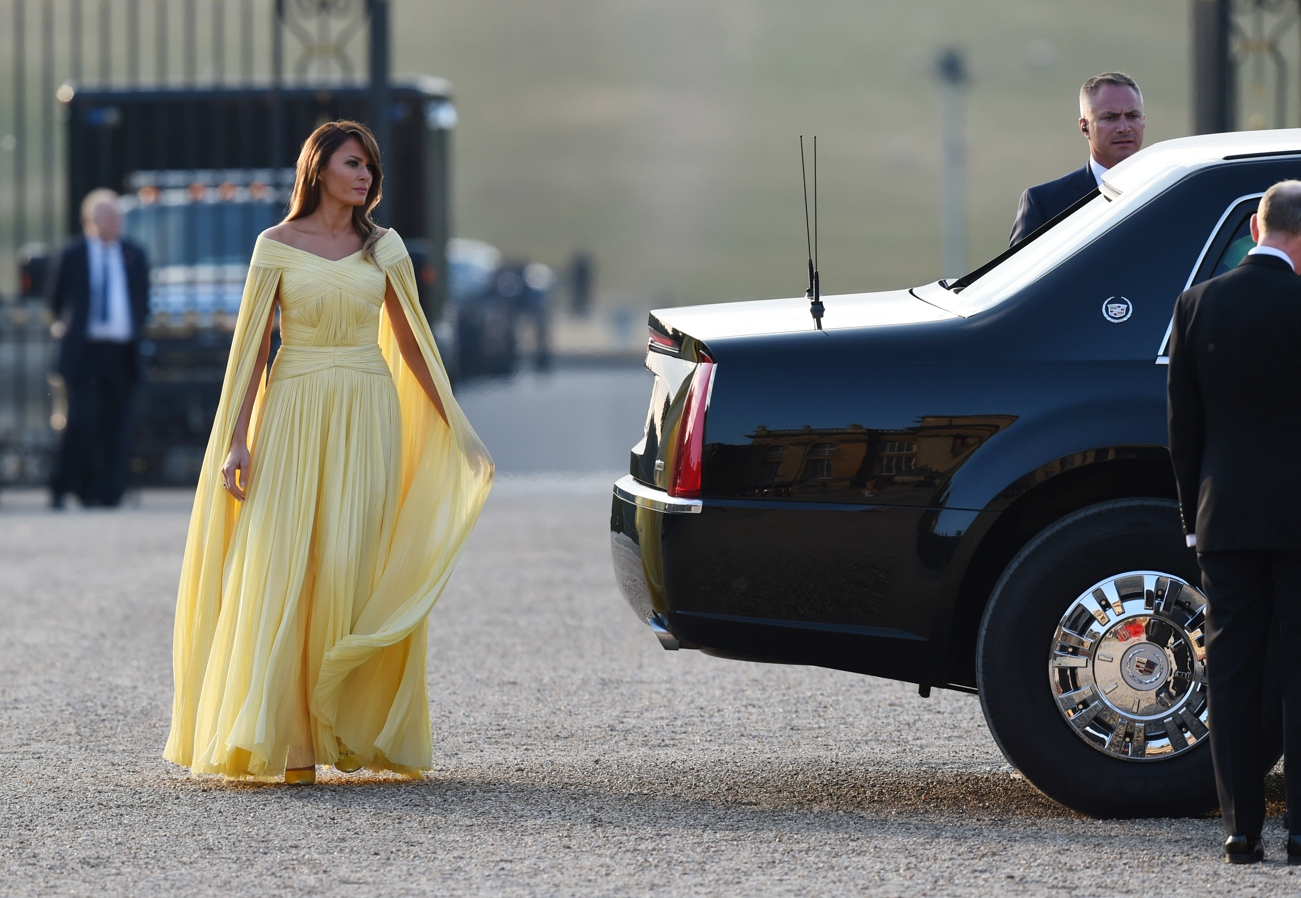 """<p>US First Lady, Melania Trump, rarely puts a foot wrong in the fashion stakes (unless she's wearing a graffitied Zara jacket) and for an appearance this week at a black-tie dinner in the UK, her style spotlight shone bright.<br /> <br /> The former model donned a floor-length pale yellow gown from American designer, J. Mendel, to meet British Prime Minister, Theresa May.<br /> <br /> Despite having a less than desired accessory in the form of her husband, Donald, on her arm, she made up for it with nude heels and a voluminous blowout.<br /> <br /> The choice of the sunny shade, a favourite colour of Queen Elizabeth II, was intentional and worn by Trump to """"pay homage"""" to her majesty, according to her personal stylist, Herve Pierre.<br /> <br /> The First Lady wasn't the only one who caused a stir in the style stakes this week. <a href=""""https://style.nine.com.au/2018/07/11/08/34/meghan-markle-ireland"""" target=""""_blank"""" title=""""The Duchess of Sussex,"""">The Duchess of Sussex,</a> Naomi Campbell and Kourtney Kardashian also gave us plenty to talk about.</p> <p>Click through to see the most talked about looks of the week.</p>"""