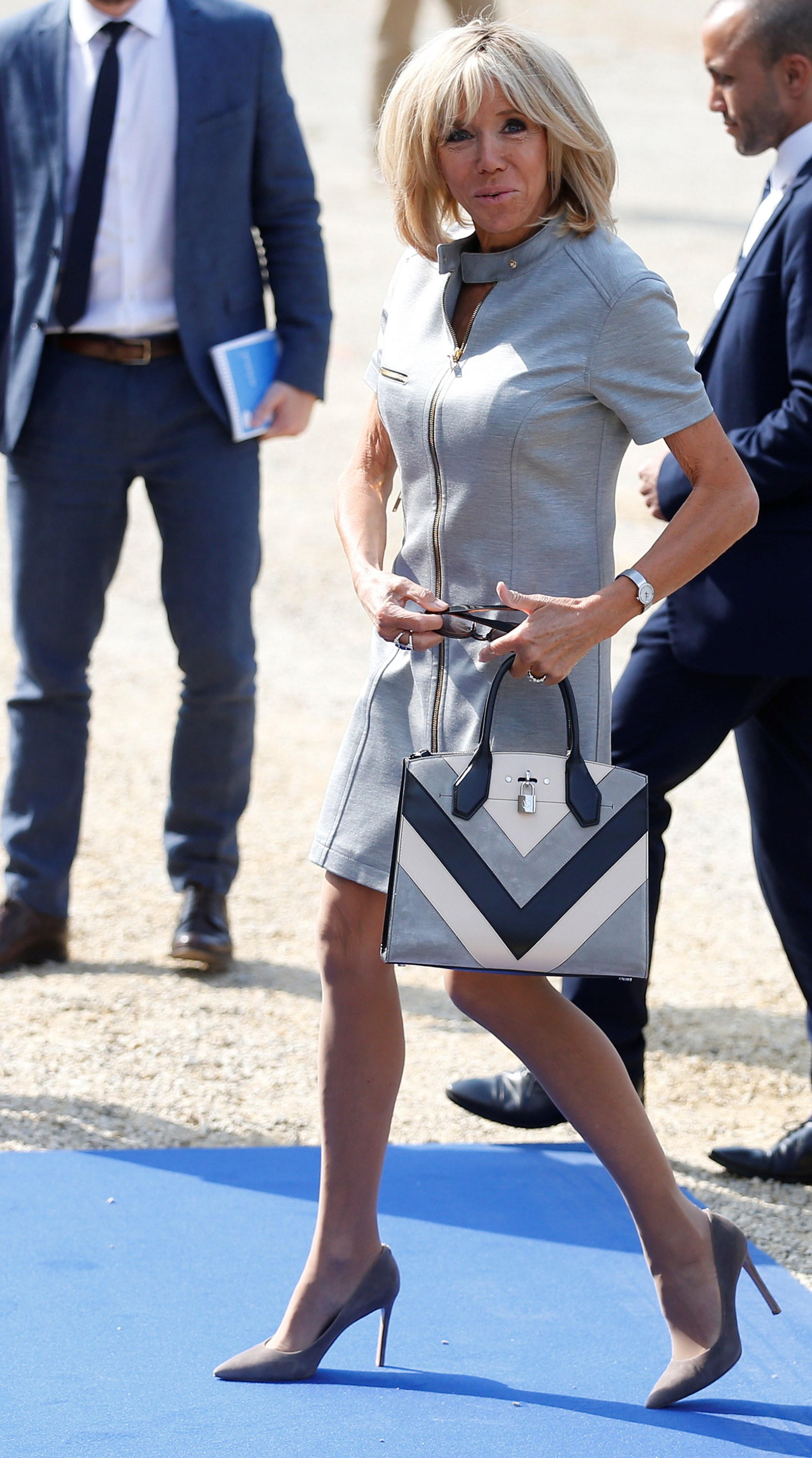 """<p><a href=""""https://style.nine.com.au/2017/07/14/11/08/style_melania-and-brigitte"""" target=""""_blank"""" title=""""Brigitte Macron"""" draggable=""""false"""">Brigitte Macron</a> is redefining First Lady style (pay attention Melania), and she's gone and done it again overnight.</p> <p>The striking 64-year-old, also known as Brigitte Trogneux, has been dubbed the Jane Fonda of France by the Parisian press and with good reason.</p> <p>Macron is in Belgium where she headed to a post-NATO summit dinner overnight with husband President Emmanuel Macron, looking every inch the fashion royalty that she is.</p> <p>Wearing one of her go-to designers, <a href=""""https://style.nine.com.au/2018/05/30/12/20/louis-vuitton-cruise-2018-emma-stone-jennifer-connolly"""" target=""""_blank"""" title=""""Louis Vuitton"""" draggable=""""false"""">Louis Vuitton</a>, Macron donned a grey mod a-line mini dress, in other words, a stand-out.</p> <p>She accessorised her look with grey suede pumps and a Louis Vuitton City Steamer bag.</p> <p>Macron has been forming a relationship with Louis Vuitton since 2014, following a meeting with Delphine Arnault, executive vice president of Louis Vuitton.</p> <p>Macron's approach to dressing fails to take into account traditional notions of what mature women want and her rock chic style has already struck a chord.</p> <p>""""She's rock'n'roll. Not for a second does she say, 'I'm 63, so I cannot wear short skirts.' Twelve-inch heels, sleeveless dresses, leather trousers, she dares everything,"""" Delphine de Canecaude, a Paris-based art director, toldL'Express: """"She is a mega wonder woman.""""</p> <p>Take a look at some of the French First lady's most stylish looks.</p>"""
