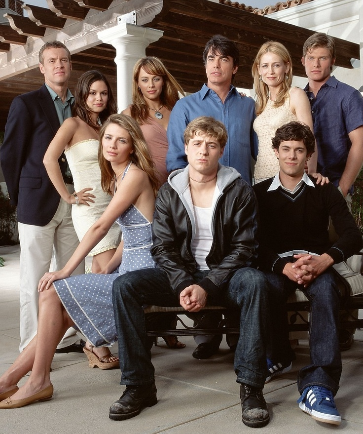 "Forget the beach backdrop, McMansions, glamorous cocktail parties and the boy from Chino, the most important star of '000s teen drama, <em>The O.C. </em>was the fashion.<br /> <br /> In the fifteen years since the show premiered in August 2003, some of the trends seen on the show haven't aged as well as the storylines (crochet bolero jackets anyone?!) but for the most part, the show's style remains iconic and an unmissable influence on <a href=""https://style.nine.com.au/2018/08/08/09/55/style-fashion-carrie-bradshaw-tube-tank-tops-fashion-sex-and-the-city-return"" target=""_blank"">early 'aughts fashion. <br /> </a> <br /> <a href=""https://style.nine.com.au/2017/07/28/15/56/tv-hair-decades-best-signature-look/9"" target=""_blank"" title=""On-screen, Marissa Cooper (played by Mischa Barton)"">On-screen, Marissa Cooper (played by Mischa Barton)</a> and Summer Roberts (played by Rachel Bilson) made Chanel clutches and Pucci ballet flats seem like something every teenager wore to school, while off-screen the young actresses quickly became firm favourites of the fashion world.<br /> <br /> Barton became a spokesperson for brands including Keds and Chanel Fine jewellery, while Bilson teamed with DNKY Jeans to co-design a new brand, called Edie Rose.<br /> <br /> In honour of  <em>The O.C</em>.'s fifteen-year anniversary, we look back at some of the most iconic style moments to come out of Orange County."