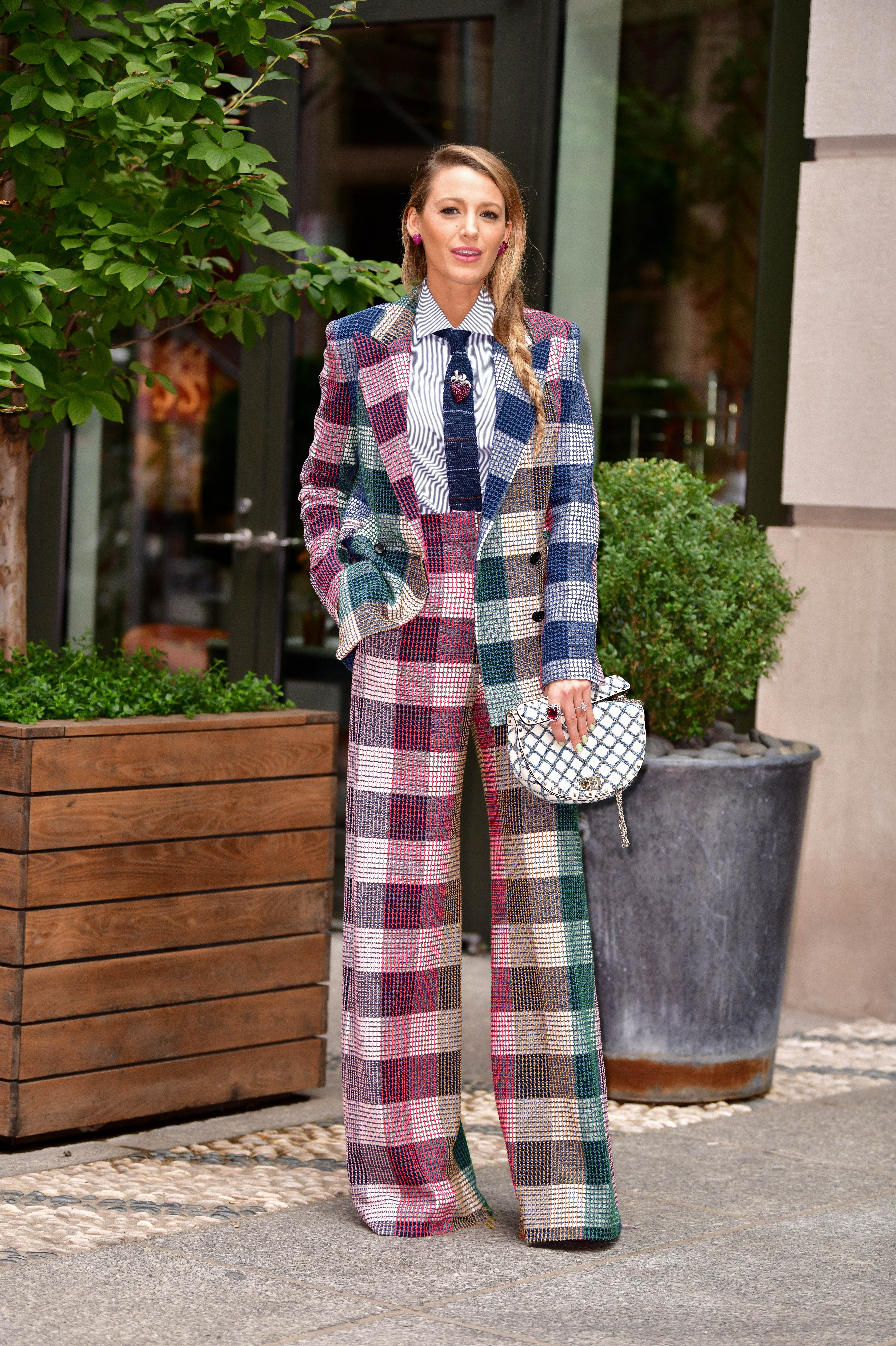 """<p>It's no secret Blake Lively is loving herself in a <a href=""""https://style.nine.com.au/2018/08/21/08/21/neon-blake-lively-kim-kardashian"""" target=""""_blank"""" title=""""pantsuit"""" draggable=""""false"""">pantsuit</a> at the moment.</p> <p>In the lastweek alone,<a href=""""https://style.nine.com.au/2018/05/15/15/33/blake-lively-style"""" target=""""_blank"""" title="""" theactress"""" draggable=""""false""""> the actress</a>has stepped out in seven pantsuits, not letting a little thing like 30+ degree heat in New York stop her from rocking the tailored aesthetic.</p> <p>From a blue velvet Brunello Cucinellisuit, to the not-to-be-missed bold<a href=""""https://style.nine.com.au/2018/08/21/08/21/neon-blake-lively-kim-kardashian"""" target=""""_blank"""" draggable=""""false"""">n</a><a href=""""https://style.nine.com.au/2018/08/21/08/21/neon-blake-lively-kim-kardashian"""" target=""""_blank"""" draggable=""""false"""">eon green Versace two-piece</a>, the former<em>Gossip Girl</em>star has had all versions covered. </p> <p>However, there is someone who isn't a fan of <em>The Age of Adeline</em> star's new suited-up obsession and he wasn't afraid to tell her. </p> <p>Perhaps he should have been.</p> <p>Lively posted an image of herself on Instagram in an all-plaid Roland Mouret suit along with the caption; """"Picnic anyone? I'll bring the tablecloth...""""</p> <p>To which one fan replied: """"I say this with so much love & respect for you babe, please hire a stylist or fire the one you're currently with.""""</p> <p>What @gabeluna may not know is that the 31 year-old is one of the few Hollywood A-lister's that actually doesn't have a stylist. She is responsible for all her own looks.</p> <p>""""Thank you for the tips, sir,"""" Lively responded to the criticism. """"Alas, I've tried to fire @blakelively so many times. But the b*tch just keeps coming back. She won't leave me alone.""""</p> <p>You go girl. We think Lively does a damn good job as her own stylist. </p> <p>Click through to see all the times Blake Lively has rocked the pantsuit trend lately.</p>"""