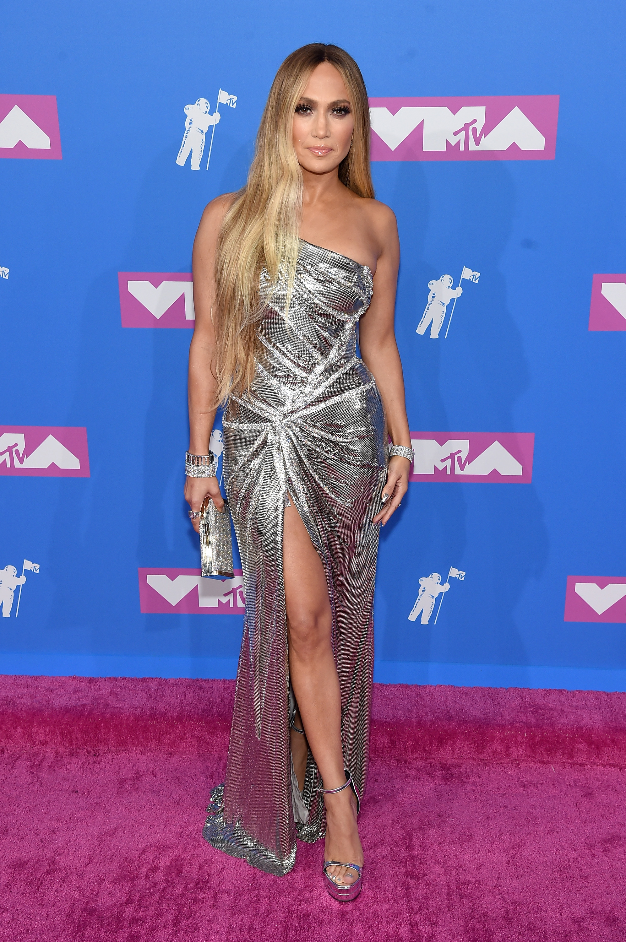 """<p>There is no disputing that Jennifer Lopez is the queen of the red carpet. </p> <p>The triple threat stole the show at yesterday's MTV Video Music Awards in a <a href=""""https://style.nine.com.au/2018/08/21/08/46/style-fashion-mtv-vma-awards-jennifer-lopez"""" target=""""_blank"""" title=""""curve-hugging silver  dress"""" draggable=""""false"""">curve-hugging metallic dress</a> by Versace, and went one step further at the after-party in a <a href=""""https://style.nine.com.au/2018/08/22/08/47/afterparty-mtv-awards"""" target=""""_blank"""" draggable=""""false"""">skintight</a><a href=""""https://style.nine.com.au/2018/08/22/08/47/afterparty-mtv-awards"""" target=""""_blank"""" draggable=""""false"""">bodysuit</a> by the luxury fashion house.</p> <p>J.Lo <a href=""""https://style.nine.com.au/2018/08/01/08/36/denim-boots-jennfifer-lopez"""" target=""""_blank"""" title=""""commanding all the attention """" draggable=""""false"""">commanding all the attention </a>at award shows is nothing new.</p> <p>Less is more is the mantra for the singer, actress and dancer who can do no wrong when it comes to making a statement with daring cuts out, plunging necklines and barely-there hems. </p> <p>The 49 year-old isn't afraid to push the boundaries. No-one can forget the infamous below-the navel Versace frock she wore to the 2000 Grammy Awards. In fact, the dress was so sought-after, Google ChairmanEric Schmidtclaims JLo's jaw-dropping outfit was the reason he launched Google Images.</p> <p>Click through to check out Jennifer Lopez's most standout (and hottest) red carpet looks.</p>"""
