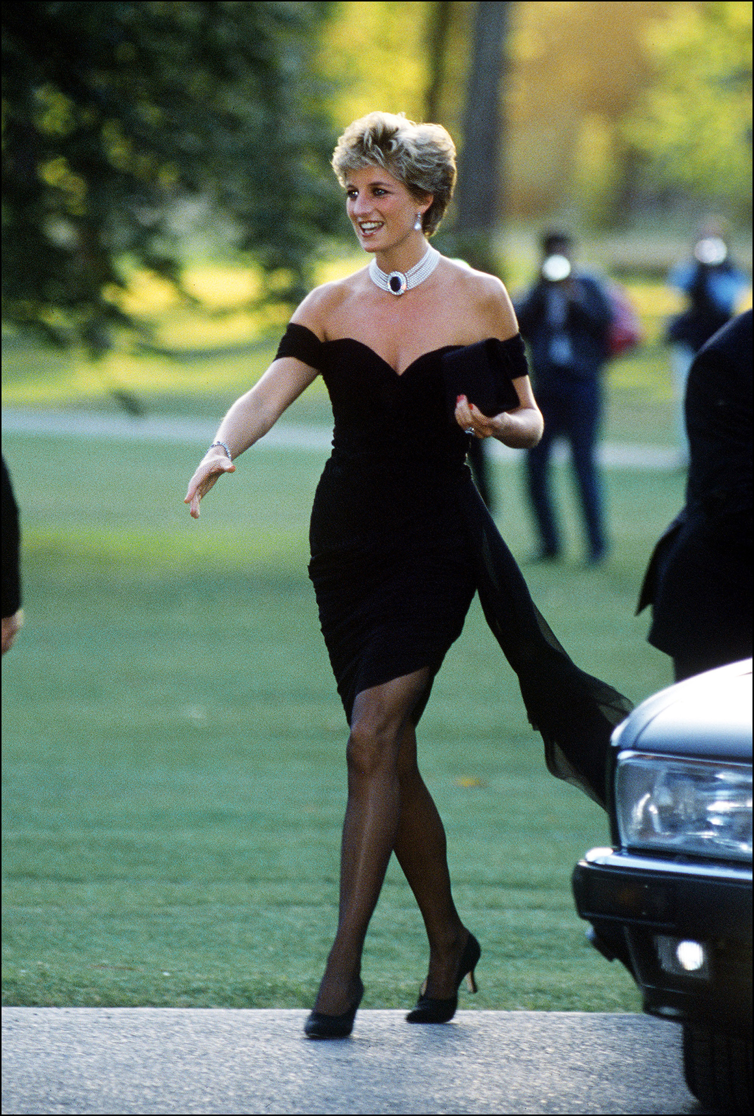 """Today marks 21 years since the tragic death of the 'people's princess'<a href=""""https://style.nine.com.au/princess-diana/2"""" target=""""_blank"""" title=""""Princess Diana"""" draggable=""""false"""">Princess Diana</a>, who died suddenly in a Paris car crash at the age of 36.<br /> <br /> During her tragically short lifetime, the Princess of Wales became a fashion pin-up credited with bringing a sense of glamour to the royal wardrobe and creating a style legacy that lives on today through her daughters-in-law – <a href=""""https://style.nine.com.au/2017/01/13/09/21/kate-middleton-blue-princess-di-nod-fashion-coat"""" target=""""_blank"""" title=""""Kate, the Duchess of Cambridge """" draggable=""""false"""">Kate, the Duchess of Cambridge </a>and <a href=""""https://style.nine.com.au/2018/07/05/10/31/meghan-markle-princess-diana-clothes-wardrobe-fashion"""" target=""""_blank"""" title=""""Meghan, Duchess of Sussex."""" draggable=""""false"""">Meghan, Duchess of Sussex.</a><br /> <br /> Diana's close association with fashion began in 1981 with her fairy tale wedding dress by British design duo, David and Elizabeth Emanuel. Later evolving to her blue velvet Victor Edelstein gown, worn on the White House dancefloor with John Travolta in 1985, to streamlined Catherine Walker gowns and Versace frocks in the '90s.<br /> <br /> """"A lot of designers say that she had this look about her that she'd just sort of run in, and run her fingers through her hair,"""" Eleri Lynn told <em><a href=""""https://www.vanityfair.com/london/2017/02/princess-diana-her-fashion-story#~o"""" target=""""_blank"""" draggable=""""false"""">Vanity Fair.</a></em><br /> <br /> """"She had really sort of transcended fashion and achieved an incredible chic and elegance,"""" Eleri added.<br /> <br /> """"All you saw was her, and the clothes became secondary to her own presence and her work.""""<br /> <br /> With the 21st anniversary of Princess Diana's death next week, we take a look back at some of her most iconic style moments."""