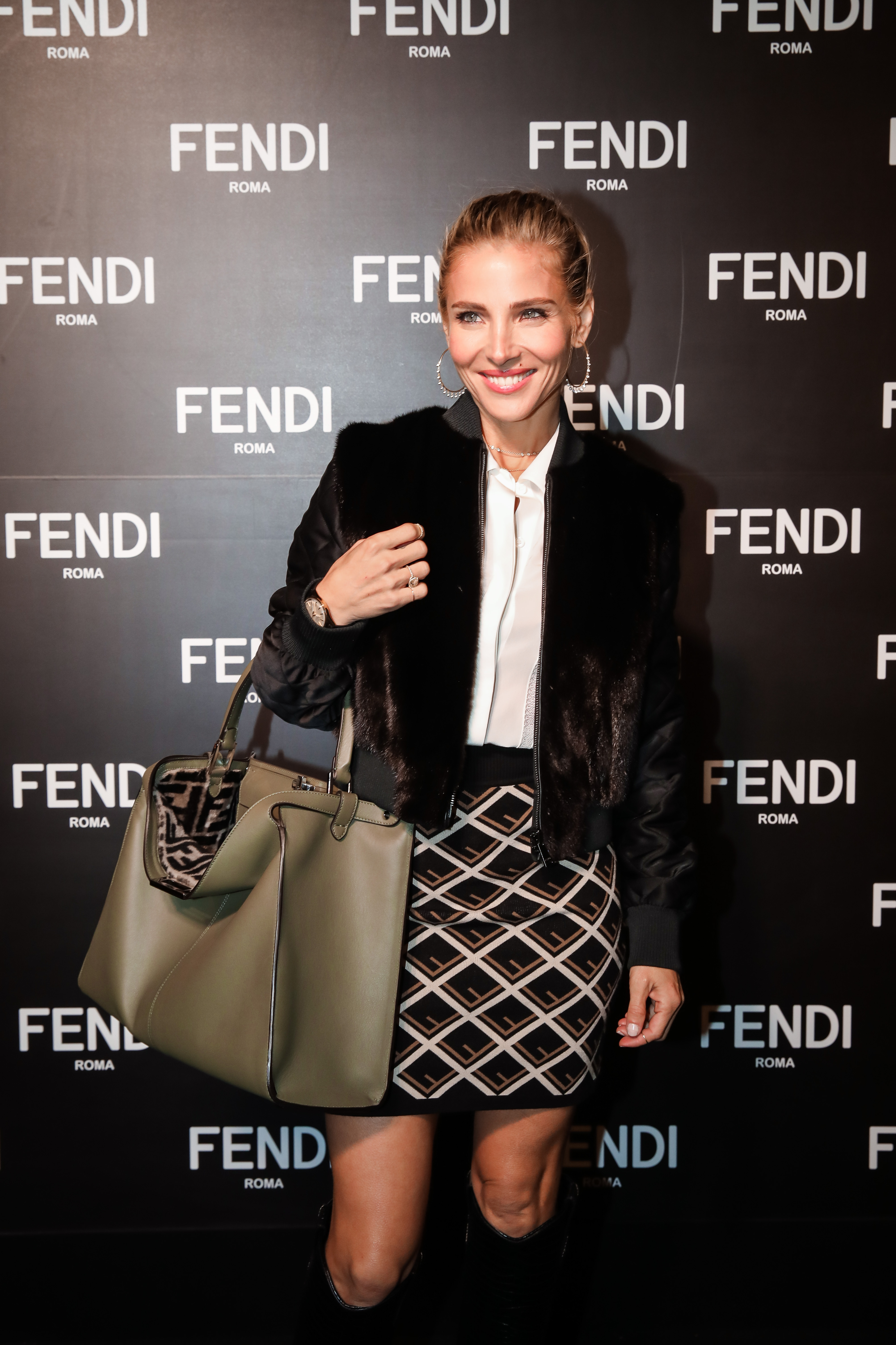 """<a href=""""https://style.nine.com.au/2018/05/02/11/22/elsa-pataky-style/18"""" target=""""_blank"""" title=""""Elsa Pataky stole the show """" draggable=""""false"""">Elsa Pataky stole the show </a>on a black carpet for the opening of Fendi's first Australian flagship boutique in Melbourne, joining the likes of David Jones ambassador Jessica Gomes, male model Jordan Barrett and <a href=""""http://https://style.nine.com.au/2018/02/28/21/50/nadia-fairfax-upside-activewear-blogger"""" target=""""_blank"""" title=""""styleblogger Nadia Fairfax."""" draggable=""""false"""">style blogger Nadia Fairfax.</a><br /> <br /> In head-to-toe attire from the luxury Italian fashion house's A/W'18 collection, the Spanish actress and wife of Chris Hemsworth looked relaxed as she mingled with Australia's fashion elite at the Collins Street-based boutique.<br /> <br /> The appearance of Pataky at the opening is a testament to just how much the mother-of-three has been embraced by her husband's homeland. Earlier this year, she attended her first Aussie fashion week in Sydney as a guest of <em>Vogue</em> and is set to star in Netflix's first-ever original Australian production, Tidelands, earlier this year.<br /> <br /> For fashion aficionados with deep pockets, the new Fendi boutique offers both the women's andmen's ready-to-wear lines, accessories and leather goods.<br /> <br /> Click through to see more of Elsa Pataky and the style highlights from the launch of Australia's first-ever Fendi flagship boutique."""