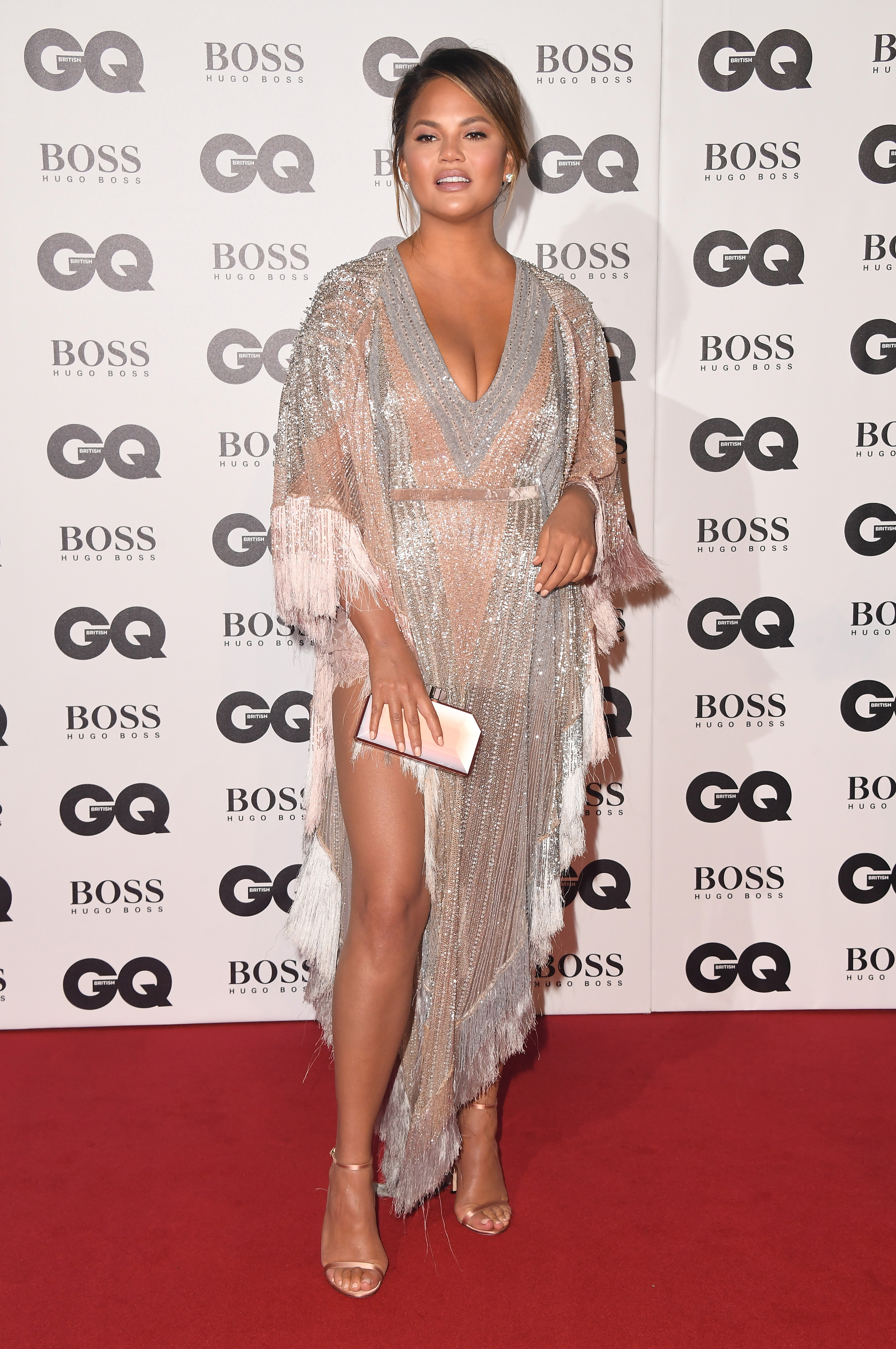 """<p>If you're looking for a good dose of glamour,  look no further than the 2018 GQ Awards<a href=""""https://style.nine.com.au/2018/08/30/10/34/venice-film-festival-fashion"""" target=""""_blank"""" title="""" red carpet"""" draggable=""""false""""> red carpet</a> at London's Tate Modern.</p> <p>The stars brought their A-game to the award show which honors both men and women who've influenced style, sport, politics and entertainment culture over the past 12 months.</p> <p>Model and author <a href=""""https://style.nine.com.au/2018/05/25/14/12/chrissy-teigen-pregnancy-style"""" target=""""_blank"""" title=""""Chrissy Teigen"""" draggable=""""false"""">Chrissy Teigen</a> hit all the right style notes in a tassled and sequinned floor length Bourjoisie x Lyla Dumont St. Barth dress. </p> <p>Meanwhile, actress Kate Bekinsale won the award for most daring dress of the night, turning heads in a revealing Julien Macdonald gown.</p> <p>Click through to take a look at all the standout looks from the star-studded event.</p>"""