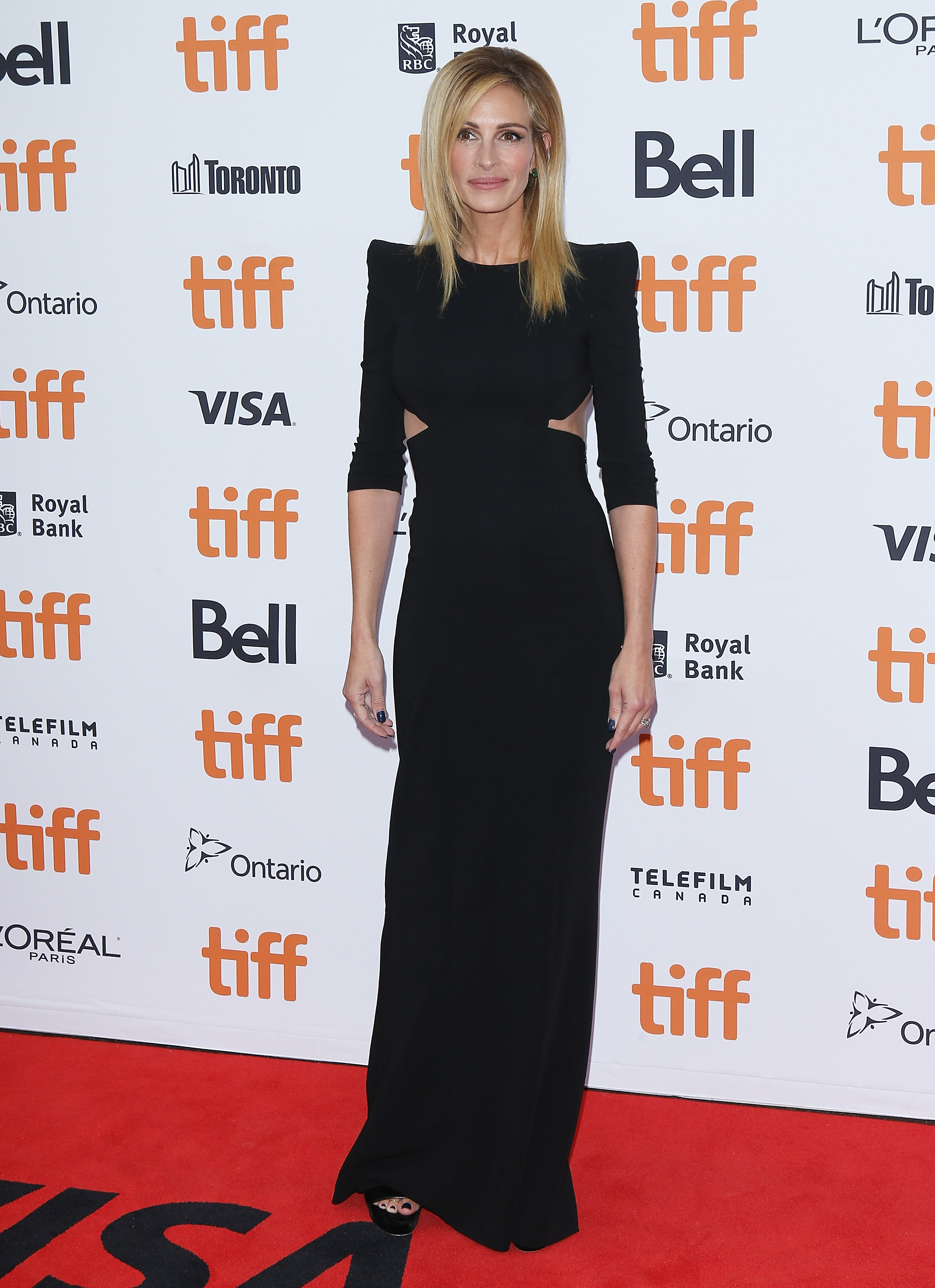"""<p>Step aside Kardashians, it's <a href=""""https://style.nine.com.au/2018/07/31/11/11/red-to-blonde-hair-julia-roberts"""" target=""""_blank"""" title=""""Julia Roberts'"""" draggable=""""false"""">Julia Roberts'</a> time to wow on the red carpet.</p> <p>The actress stepped out for the Toronto Film Festival looking every inch the movie star she is.</p> <p>The 50 year-old wowed in a floor length gown by Canadian designers, Dsquared2. The dress featured exaggerated shoulder pads and cut outs around her waist.</p> <p>Roberts' complimented her look with black Jimmy Choo heels and Lorraine Schwartz jewelry, giving off a classic, yet modern and sleek aesthetic.</p> <p>The <em>Ben is Back</em> star isn't the only A-lister to step it up in the style stakes at the festival.</p> <p><a href=""""https://style.nine.com.au/2018/05/28/16/56/lady-gaga-outfit-changes-three"""" target=""""_blank"""" title=""""Lady Gaga """" draggable=""""false"""">Lady Gaga </a>wore a dramatic evening gown byArmani Privé while chunky jewels from Chopard added even more sparkle to her 'Old Hollywood' glam look.</p> <p>Click through to see all the  highlights from the Toronto Film Festival red carpet.</p>"""