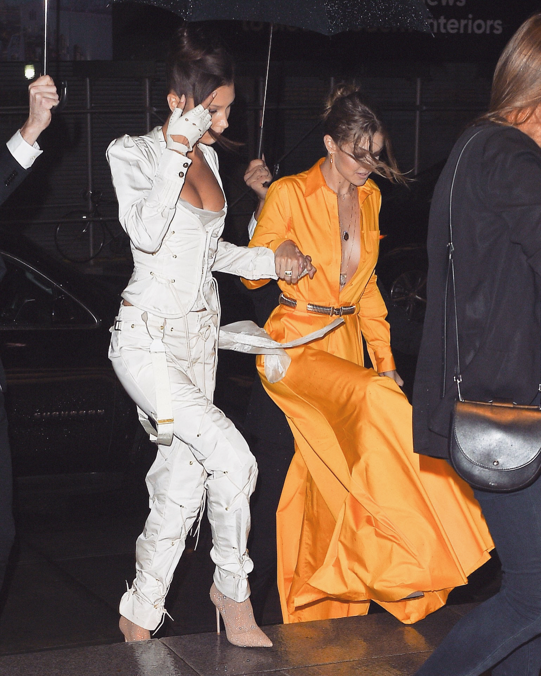 """<p>Gigi and Bella Hadid are nailing New York Fashion Week for 2018. The high-flying fashion moguls didn't hold back in the sartorial department when they stepped out for the Business of Fashion's Gala Dinner.<br /> <br /> <a href=""""https://style.nine.com.au/2018/02/12/16/25/gigi-hadid-body-shamers-new-york-fashion-week-twitter"""" title=""""Gigi"""" draggable=""""false"""">Gigi</a>, 23, and <a href=""""https://style.nine.com.au/2018/09/09/18/34/bella-hadid-harpers-bazaar-icons-party"""" title=""""Bella"""" draggable=""""false"""">Bella</a>, 21 were bold and busty in two very different styles, but both boasting generous necklines and svelte waists.<br /> <br /> Arriving at the Hotel Brooklyn Bridge, Gigi lit up the night in a canary-yellow jumpsuit by Brandon Maxwell which she paired with nude patent pumps from Le Silla.<br /> <br /> But it was the pink champagne encased in acrylic glass that really made the young model's outfit pop. The bottle was one of many bespoke accessories used in the<a href=""""https://style.nine.com.au/2018/09/10/11/39/lily-aldridge-rocks-runway-five-months-pregnant"""" title="""" Brandon Maxwell fashion show"""" draggable=""""false""""> Brandon Maxwell fashion show</a> recently, for which the Hadid sisters walked the runway.<br /> <br /> Meanwhile, Gigi's baby sis, Bella took grunge sports luxe to a whole new level.<br /> <br /> The youngest Hadid sister gushed spunk in a sexy Sporty Spice- style getup by Andreas Kronthaler for Vivienne Westwood. Bella added a touch of sparkle with glittery sock heels from Le Silla. <br /> <br /> This isn't the first time Gigi and Bella have made jaws drop with their savvy style. </p> <p>Scroll through to see all the times the Hadid sisters have flaunted their fashion flair together.</p>"""