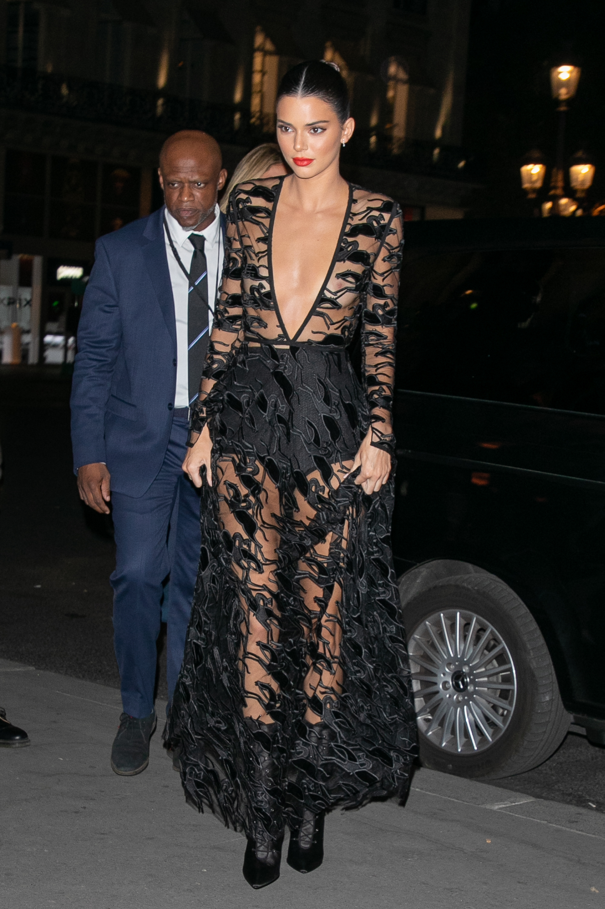 """<p><a href=""""https://style.nine.com.au/2018/09/12/11/10/russell-james-angels-victorias-secret"""" target=""""_blank"""" title=""""Kendall Jenner"""" draggable=""""false"""">Kendall Jenner</a> knows a thing or two about <a href=""""https://style.nine.com.au/2018/09/12/11/10/russell-james-angels-victorias-secret"""" target=""""_blank"""" title=""""standing out from the crowd"""" draggable=""""false"""">standing out from the crowd</a>, and stepping out for a Longchamp event at Opera Garnier in Paris overnight, the model didn't disappoint.</p> <p>The <em>Keeping up with the Kardashians</em> star turned heads at the Luxury label's 70th anniversary partywearing a floor-skimming sheer lace dress, pairing the bold frock with black lace-up boots and a red lip.</p> <p>Jenner is a new brand ambassador for the fashion house, attending theLongchampfashion showduring New York Fashion Week earlier this week.</p> <p>The model-of-the-moment is no stranger to a <a href=""""https://style.nine.com.au/2018/08/01/12/13/style-what-to-wear-kendall-jenner-corset-trackies"""" target=""""_blank"""" title=""""daring number"""" draggable=""""false"""">daring number</a>. Take a look at all the times the 22 year-old has commanded attention and embraced the sheer-and-braless look.</p>"""