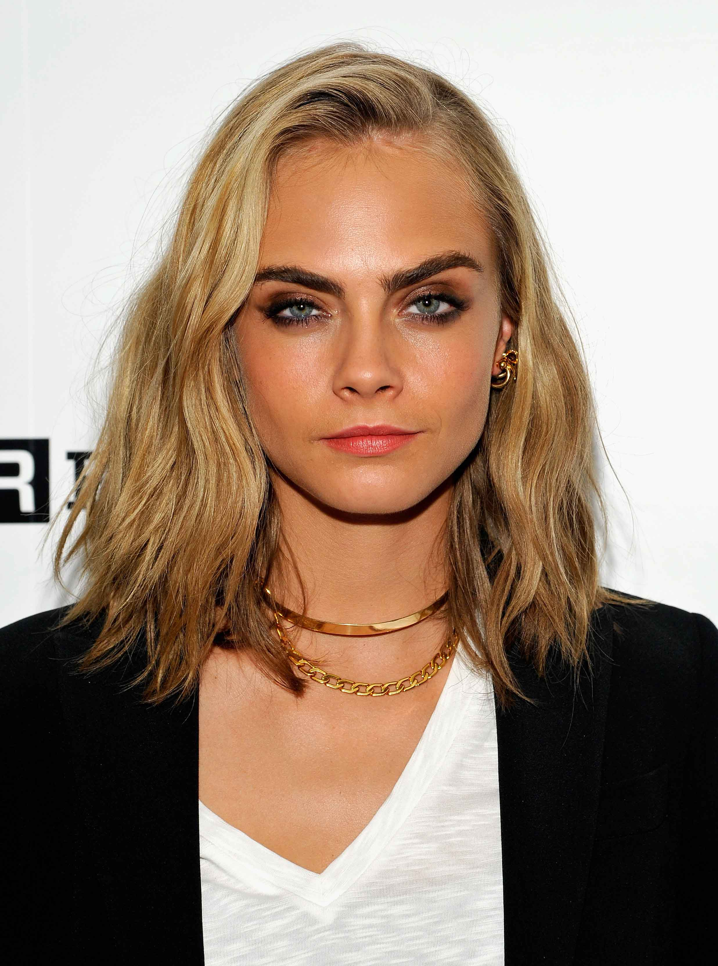 <p>After uploading a cryptic Instagram post hinting at a new look, Cara Delevingne has finally debuted a fresh cut at Comic Con. Ditching her trademark dark blonde lengths, Delevingne opted for a laid-back wavy bob in a significantly lighter shade than usual. </p> <p>She's not the only one who's decided to mix it up either; click through to find your perfect A-list hair inspiration, from Mila Kunis' short 'do to Emma Roberts' platinum mane.</p>