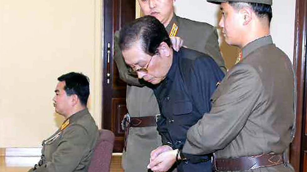 Kim's uncle General Jang Song-Thaek being led into a courtroom in 2013.