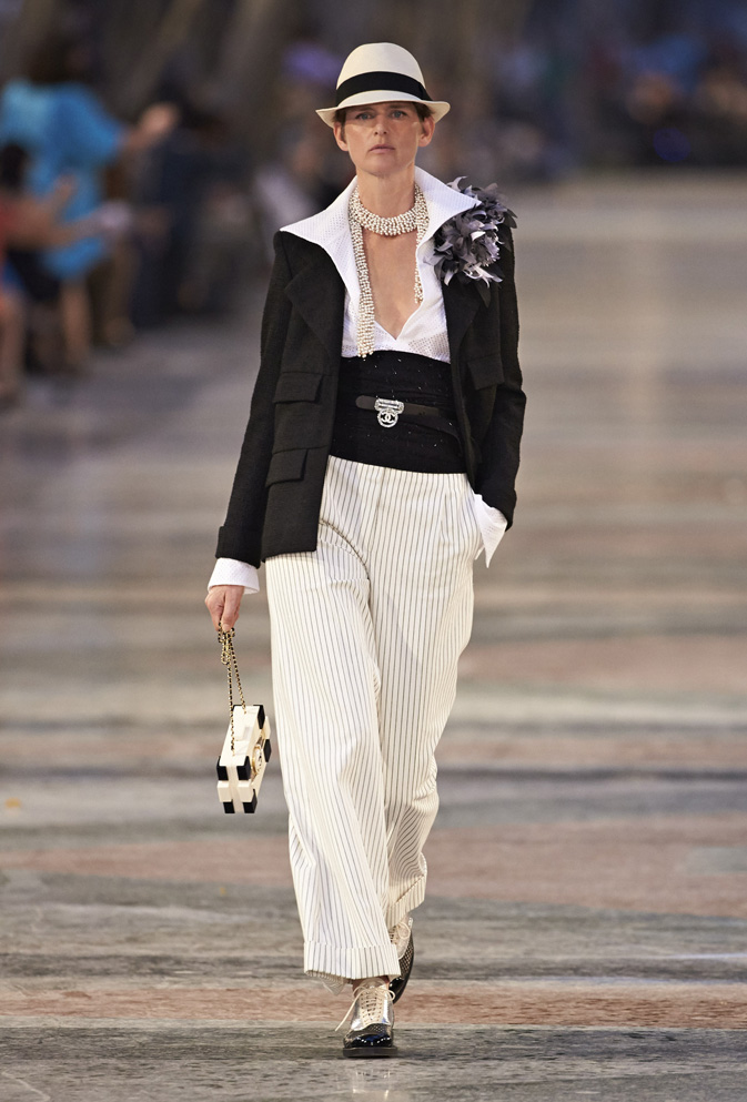 Karl Lagerfeld docked in Havana, Cuba, for Chanel's 2016/17 Cruise Collection. An explosion of colour and fun, the collection, which was held in the historic Paseo del Prado, riffed on classic Cuban silhouettes and motifs from mambo music and cigars to the guayabera and Panama hat.