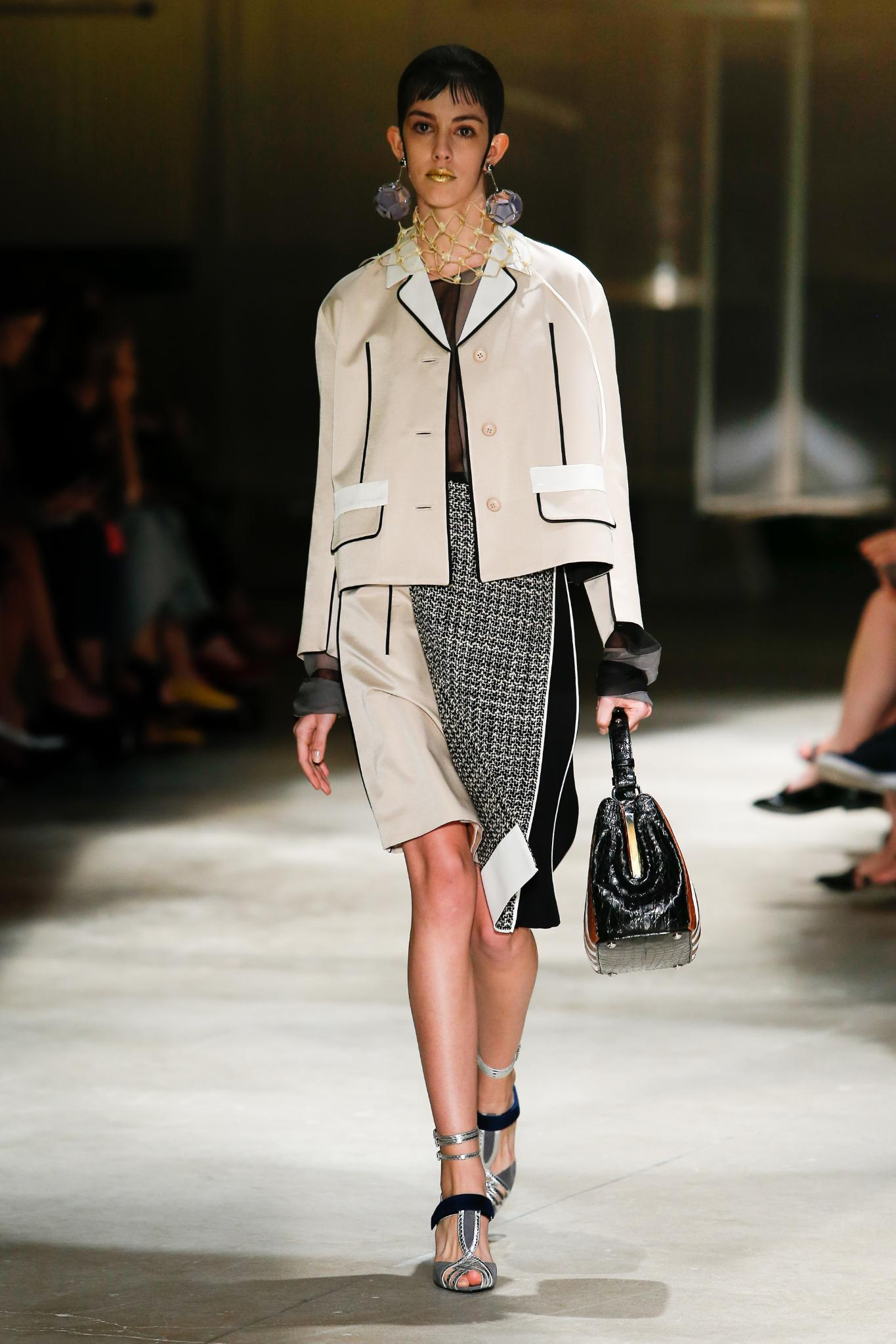 At the heart of Miuccia Prada's spring/summer collection were boxy jackets and midi skirts decorated in stripes, embellishments and mannish tweeds.