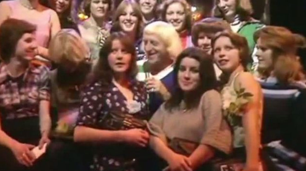 These videos of TV personalities Freddie Starr, Jimmy Savile and Gary Glitter in their heyday are now being viewed in a new light. Click through the gallery to view the clips.
