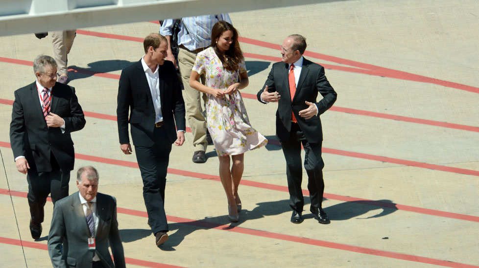 Prince William and Kate, Duke and Duchess of Cambridge, arrive for a refuelling stop in Brisbane.