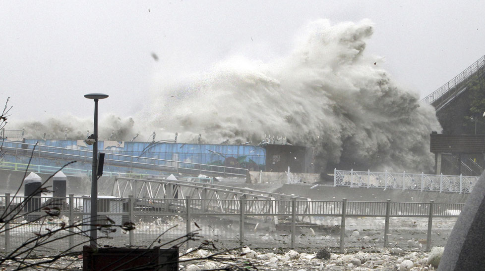 High waves, caused by Typhoon Sanba, crash on a seaside road in Yeosu, south of Seoul. (All photos AAP)