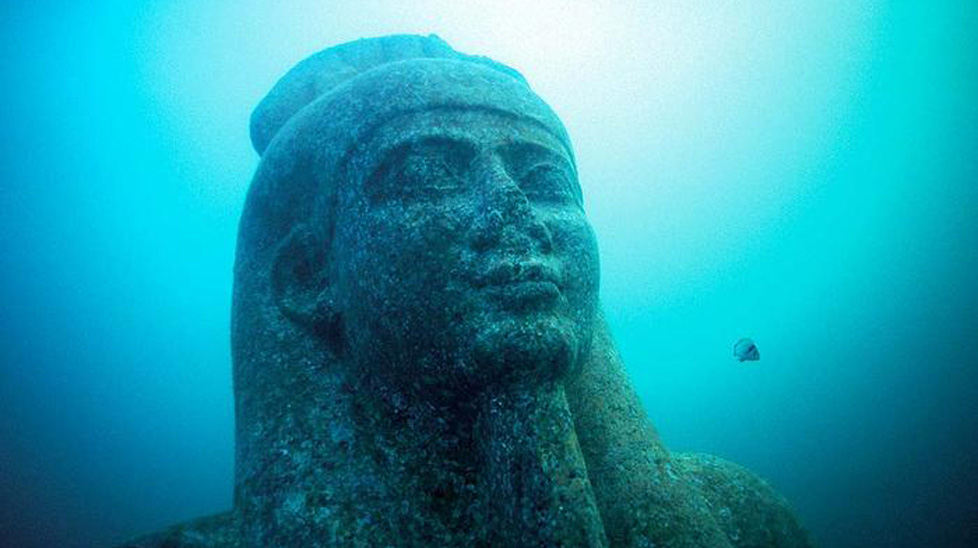The head of a 5.4 metre statue of red granite representing the god Hapi, which decorated the temple of the underwater ancient city of Heracleion. The god of the flooding of the Nile, a symbol of abundance and fertility, has never before been discovered at such a large scale. This points to his importance for the Canopic region. (Franck Goddio/Hilti Foundation)