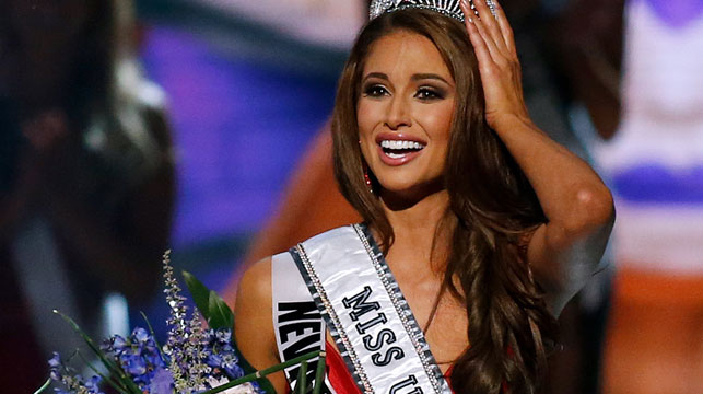 Nia Sanchez receiving her Miss USA tiara last week. Click through to see some of the funniest beauty queen answers. (AAP)