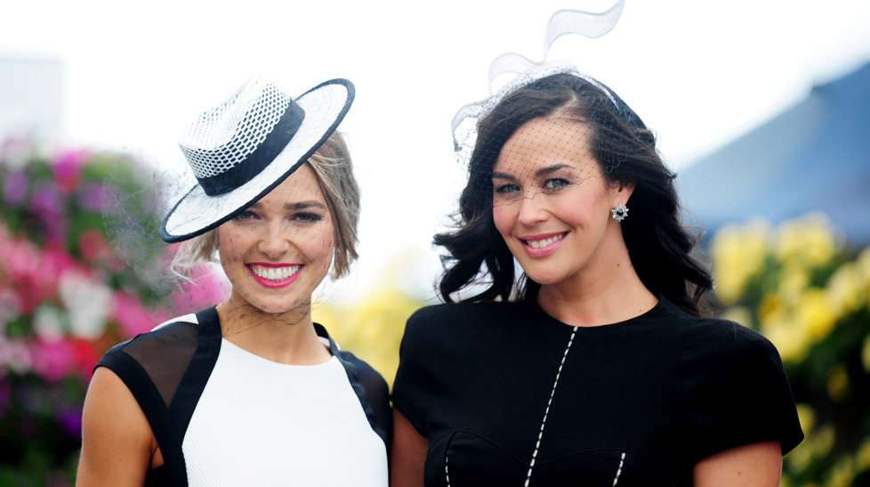 Derby Day at Melbourne's Flemington Racecourse where it was black and white and grey all over today – even in the sky. The strong winds and rain did not deter the women from stepping out into the crisp air in equally crisp frocks and fascinators. Like models Ash Hart and Megan Gale looking pleasing in their black and white ensembles (All photos courtesy of AAP).