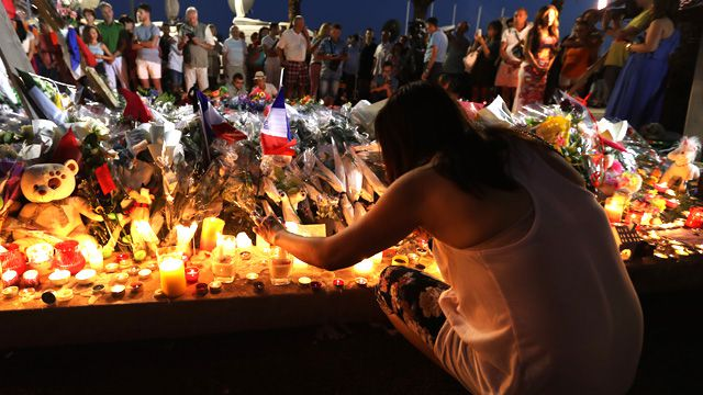 Nice attack: Tears fall as bloody road becomes tribute for victims