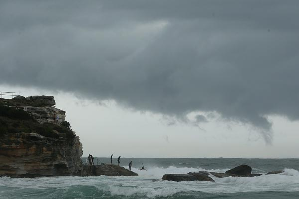 Rainfall like that experienced on Australia's east coast this week could be less common in the future. (AAP)